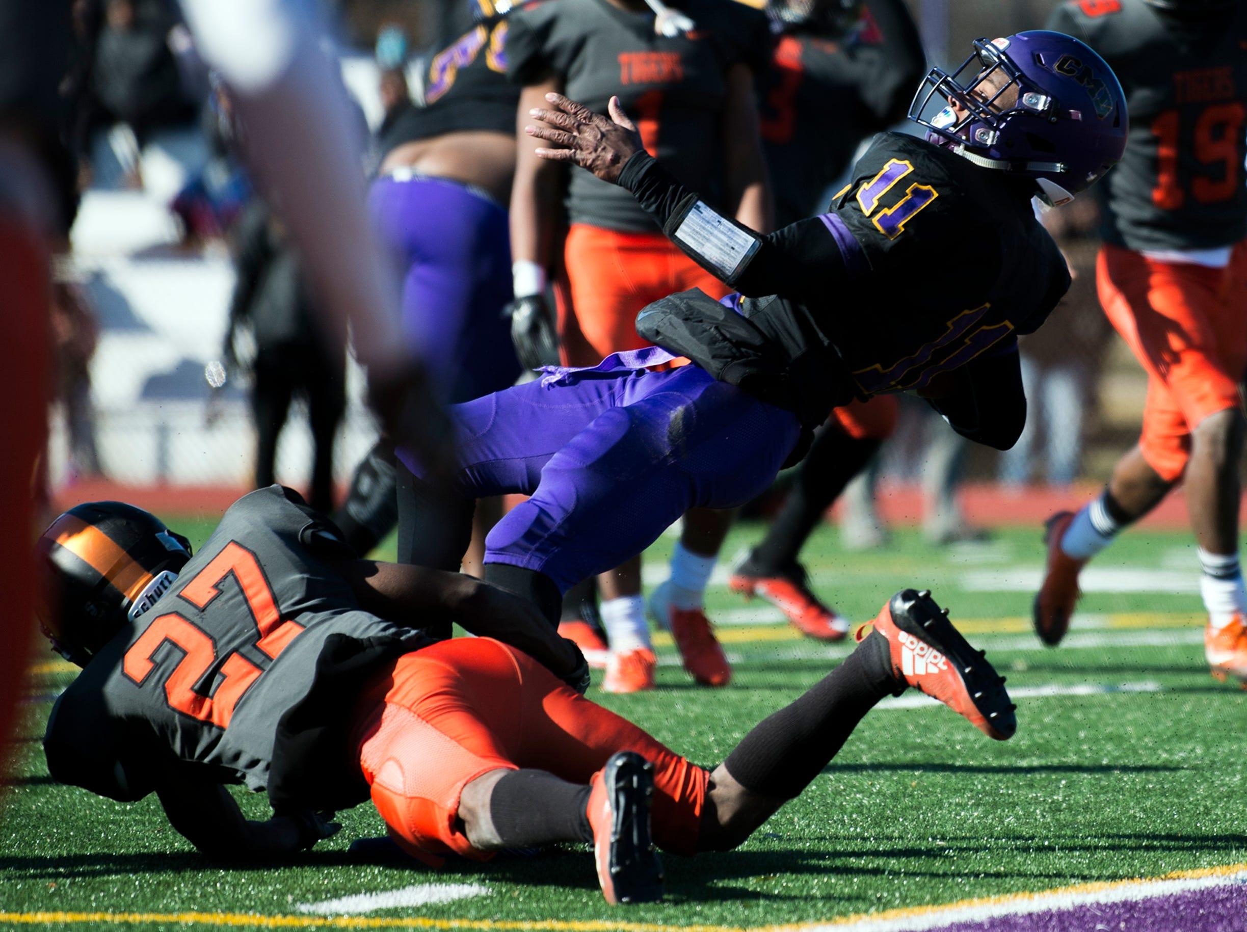 Camden's Monte Williams (11) scores a touchdown during an annual Camden-Woodrow Wilson Thanksgiving game Thursday, Nov. 22, 2018 in Camden, N.J. Camden won 39-28.