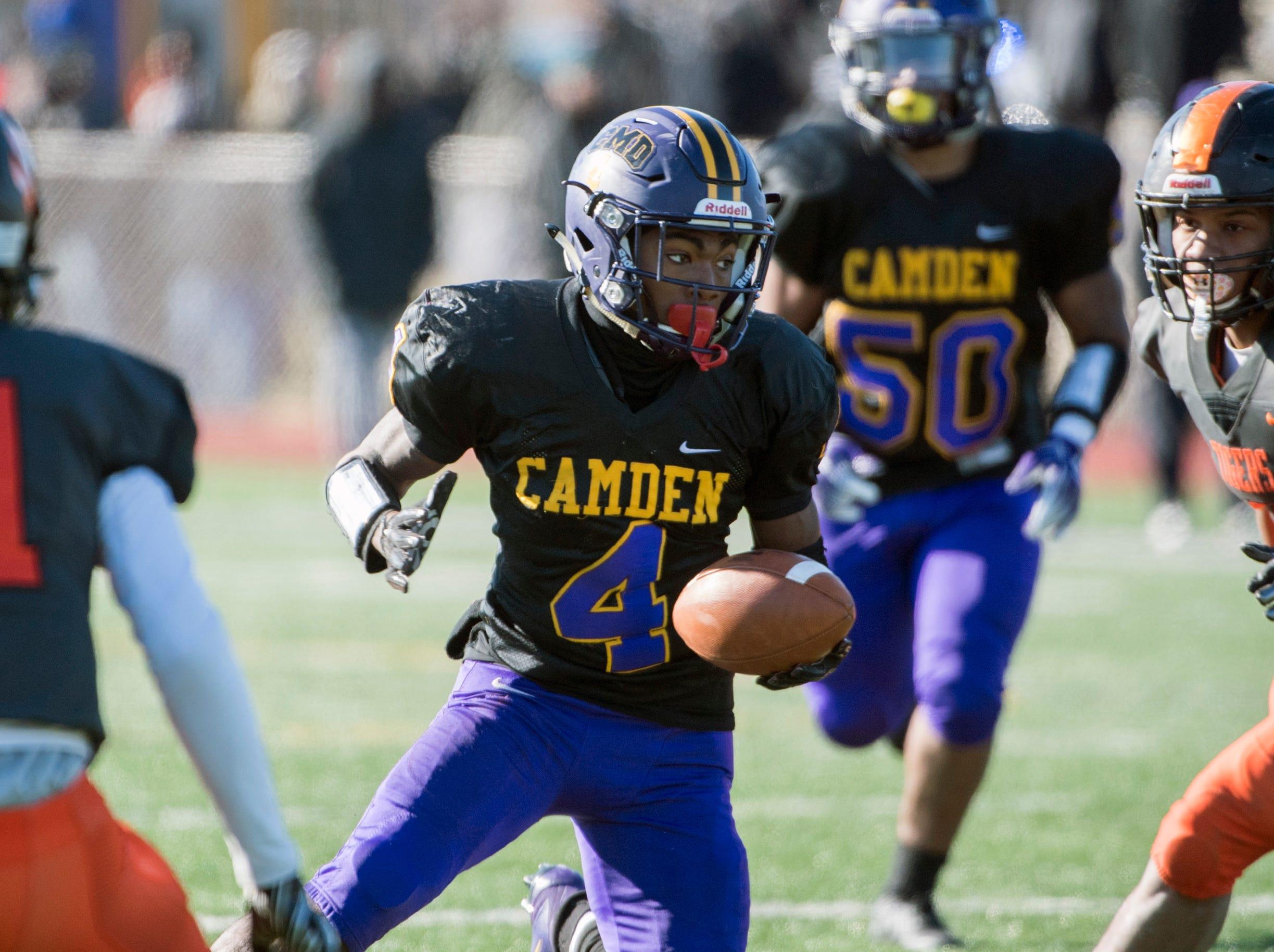 Camden's Jajuan Hudson (4) rushes during an annual Camden-Woodrow Wilson Thanksgiving game Thursday, Nov. 22, 2018 in Camden, N.J. Camden won 39-28.