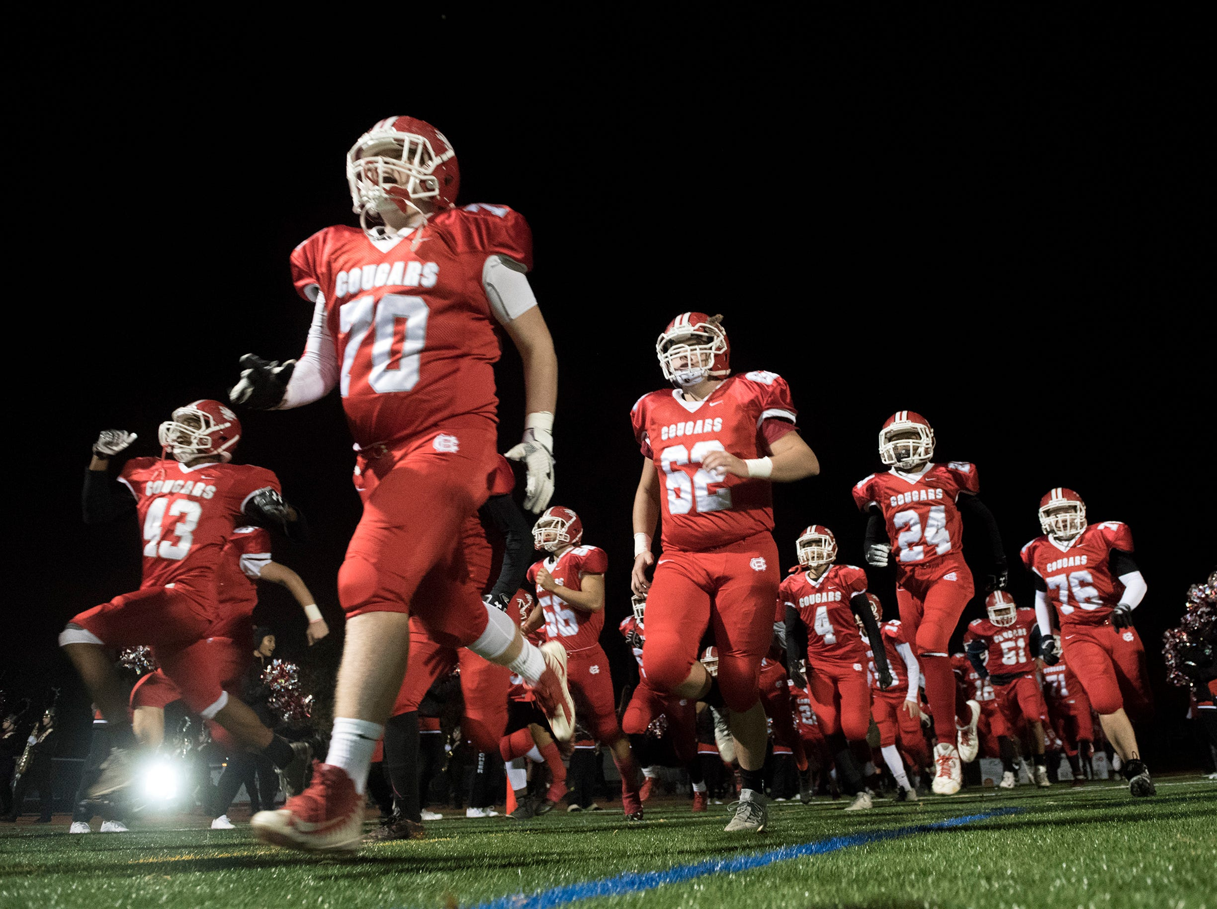 Cherry Hill East takes the field before an annual East-West game Wednesday, Nov. 21, 2018 at Cherry Hill West High School in Cherry Hill, N.J. West won 22-7.