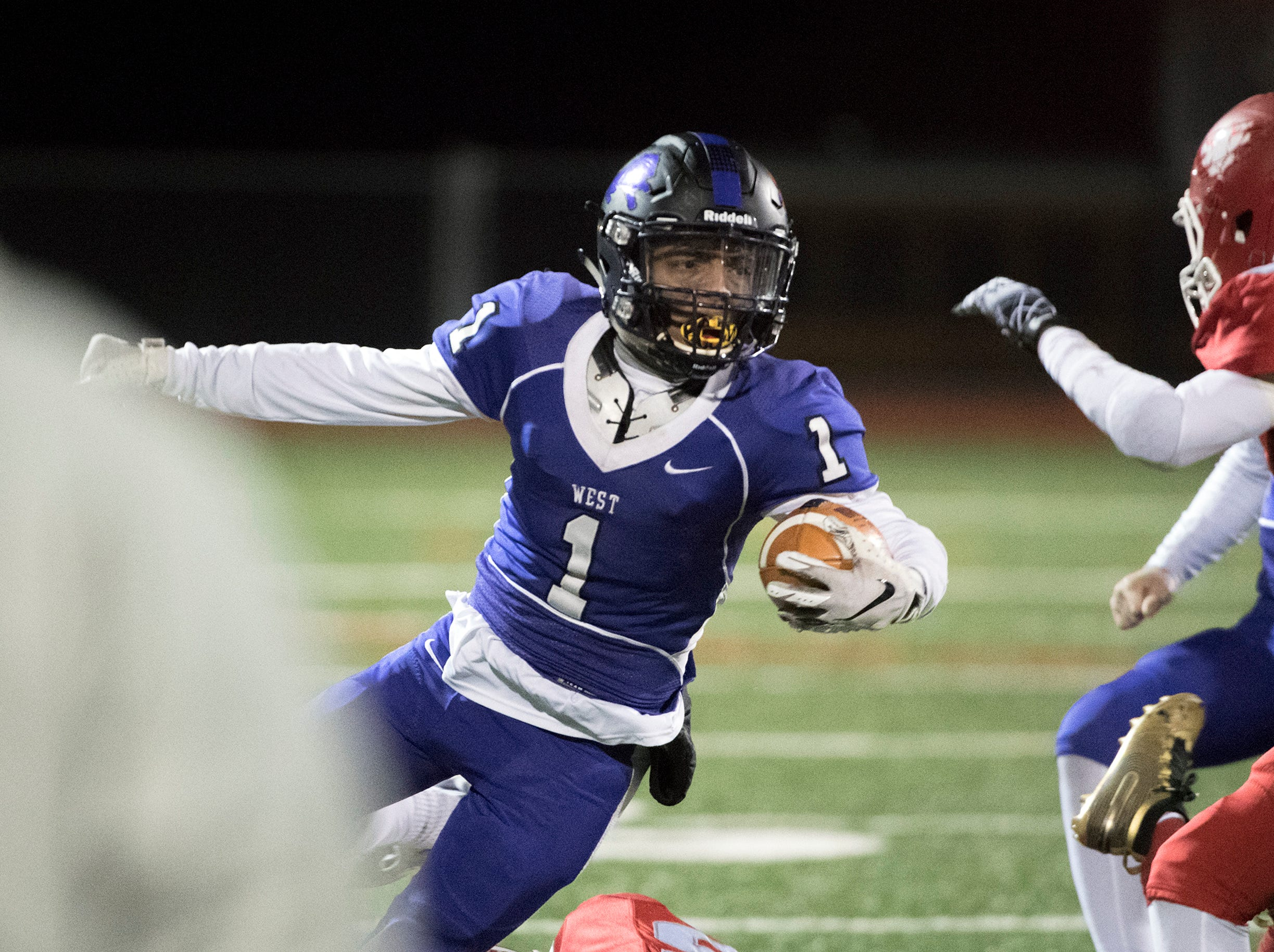 West's Carlos Gomez Jr. (1) carries the ball during an annual East-West game Wednesday, Nov. 21, 2018 at Cherry Hill West High School in Cherry Hill, N.J. West won 22-7.