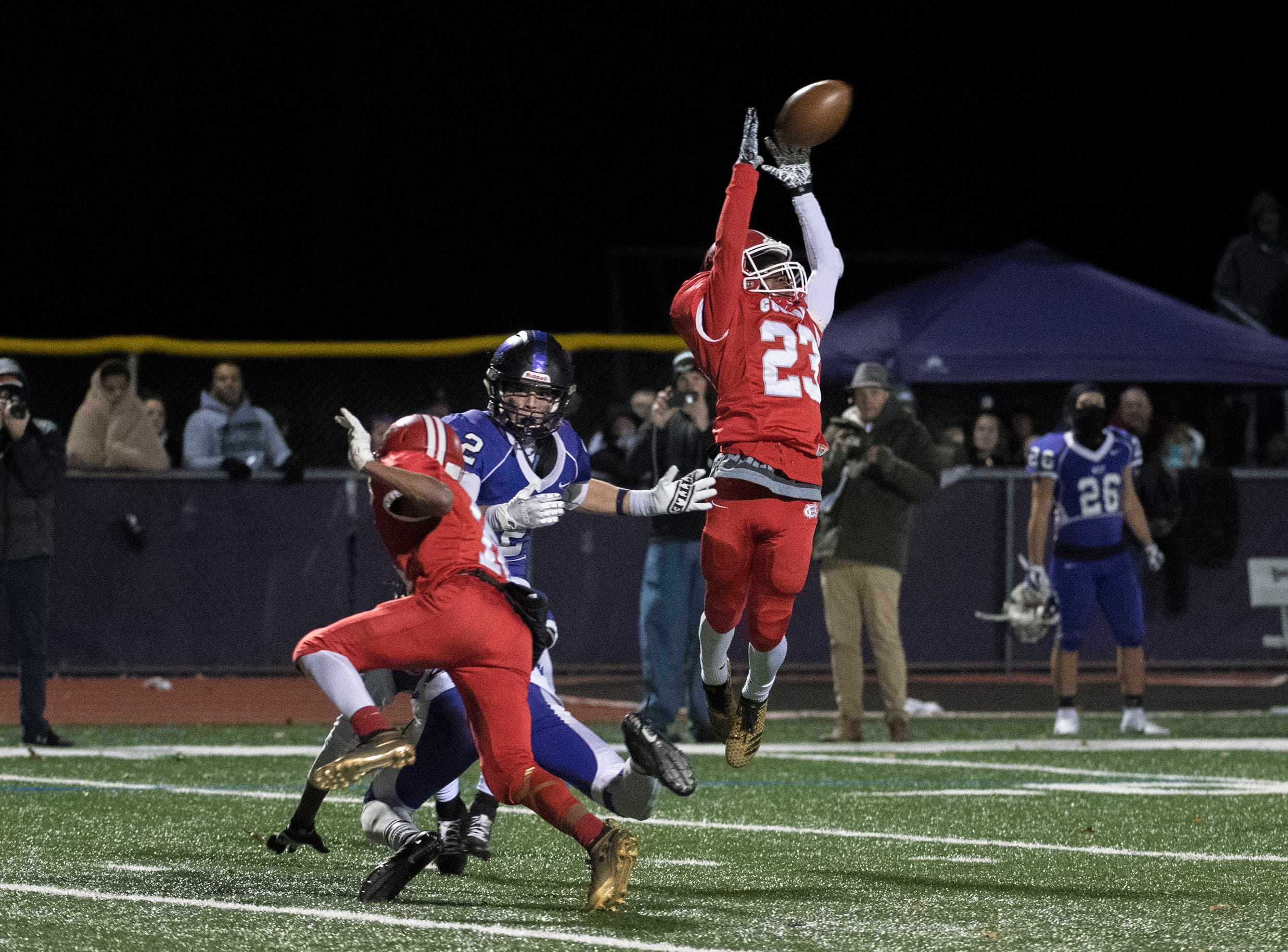 East's Joshua Jean-Baptiste (23) nearly picks off a pass during an annual East-West game Wednesday, Nov. 21, 2018 at Cherry Hill West High School in Cherry Hill, N.J. West won 22-7.