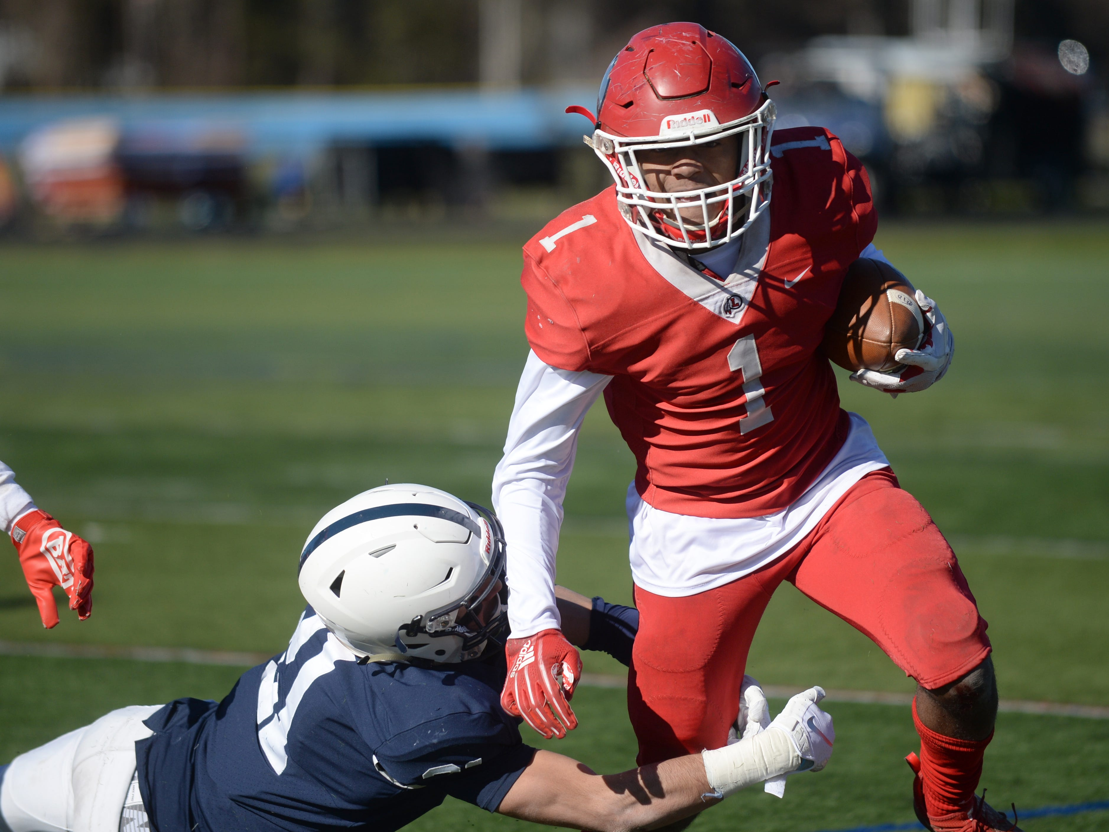 Lenape's Xavier Coleman breaks a tackle by Shawnee's Brian Muller as he carries the ball during the Thanksgiving Day football game at Shawnee High School, Thursday, Nov. 22, 2018.