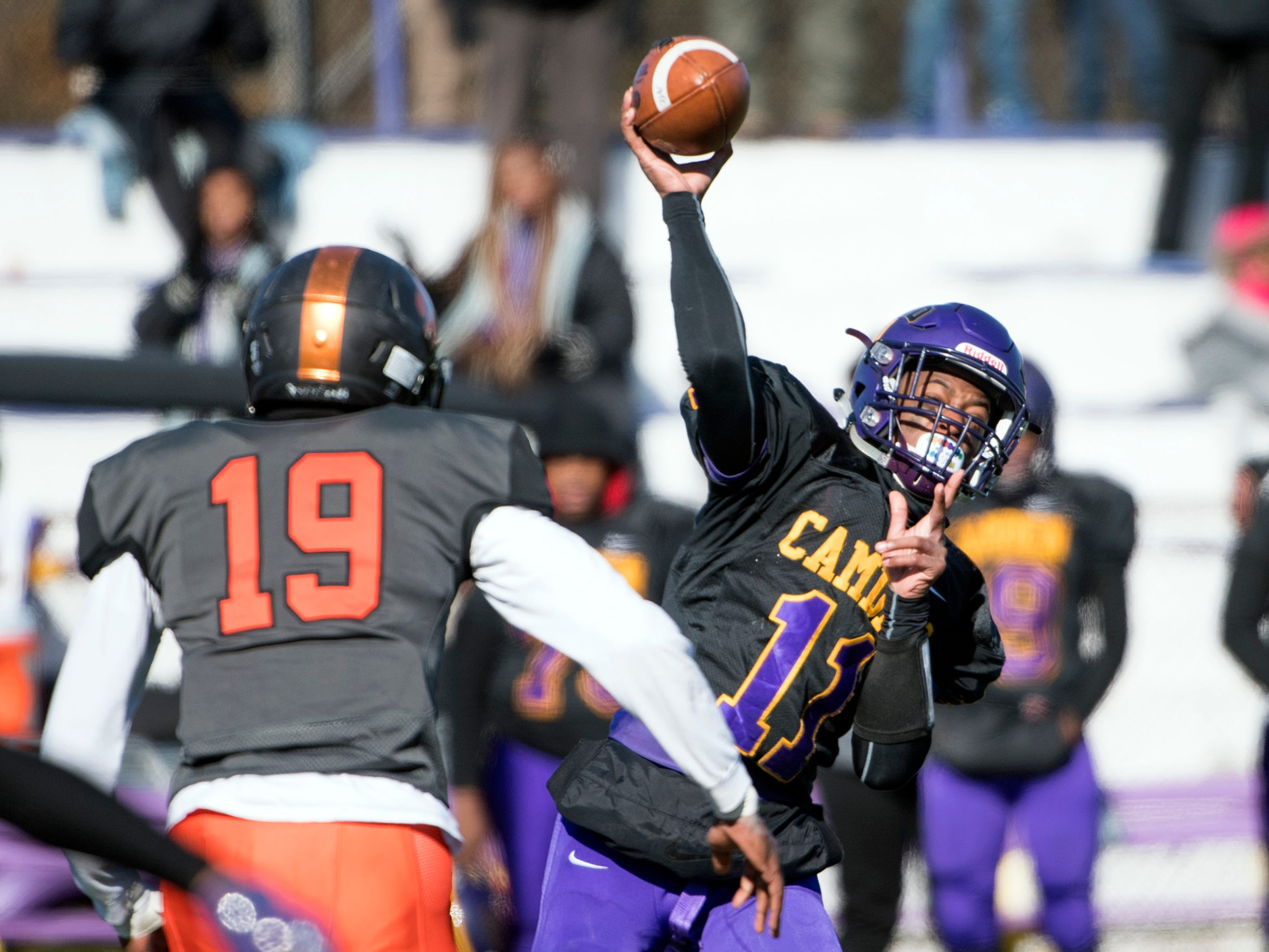 Camden's Monte Williams (11) passes the ball during an annual Camden-Woodrow Wilson Thanksgiving game Thursday, Nov. 22, 2018 in Camden, N.J. Camden won 39-28.