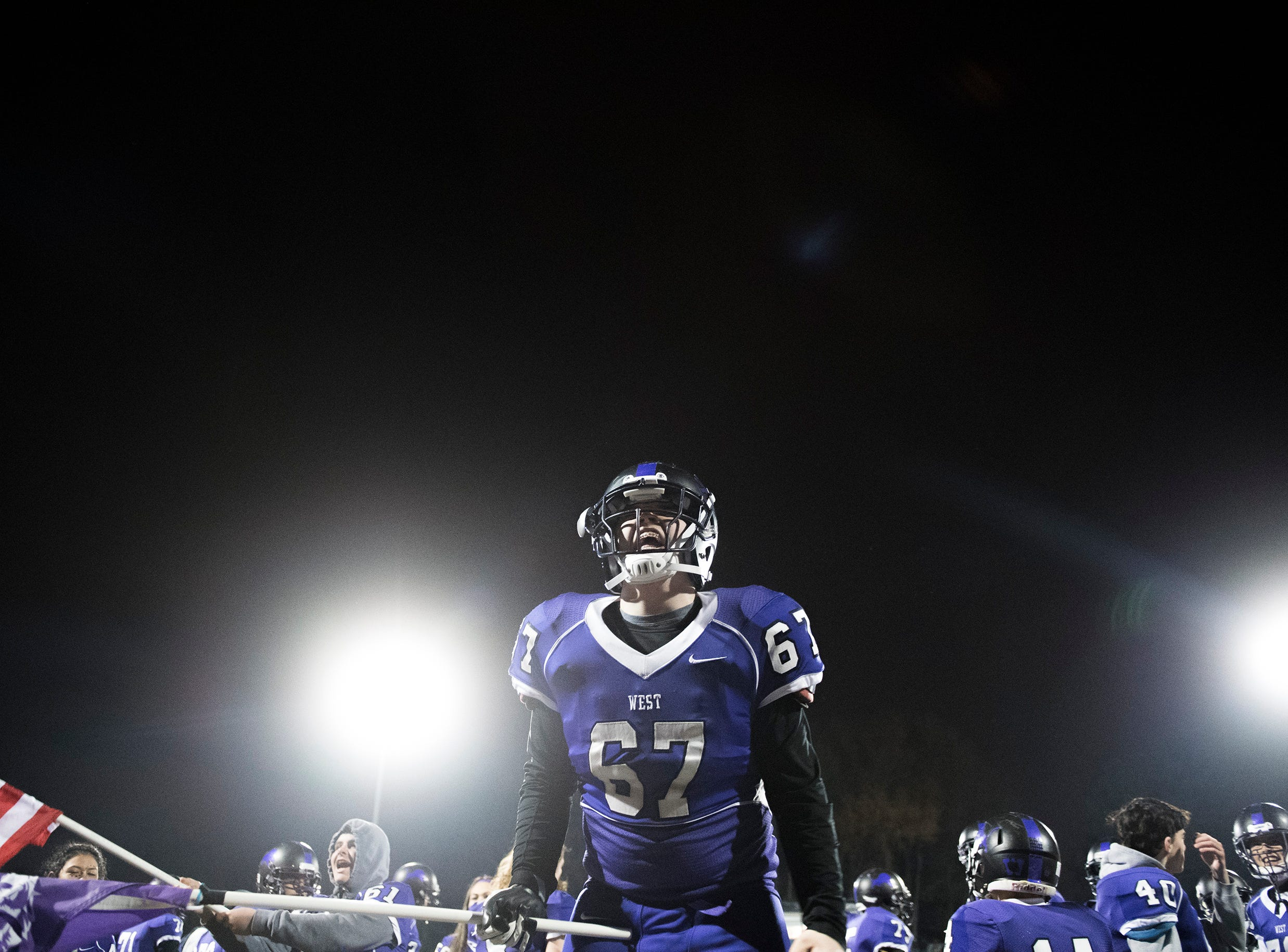 West's Seamus Curran (67) cheers as West seals a victory during an annual East-West game Wednesday, Nov. 21, 2018 at Cherry Hill West High School in Cherry Hill, N.J. West won 22-7.