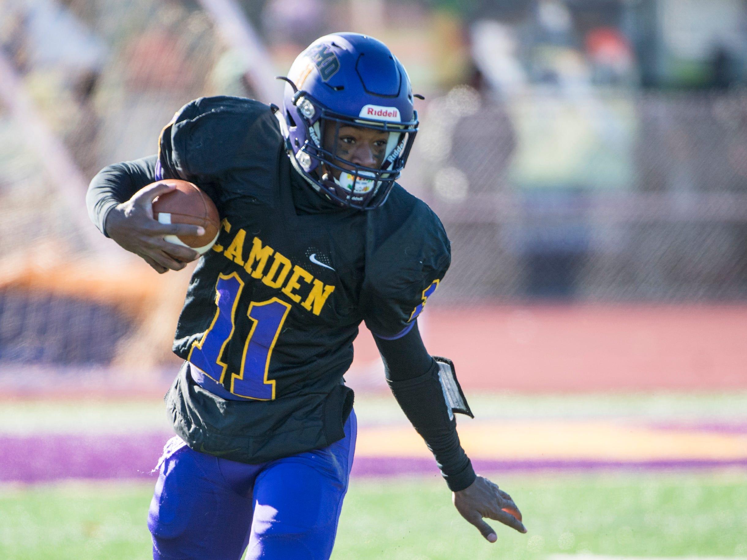 Camden quarterback Monte Williams (11) rushes during an annual Camden-Woodrow Wilson Thanksgiving game Thursday, Nov. 22, 2018 in Camden, N.J. Camden won 39-28.