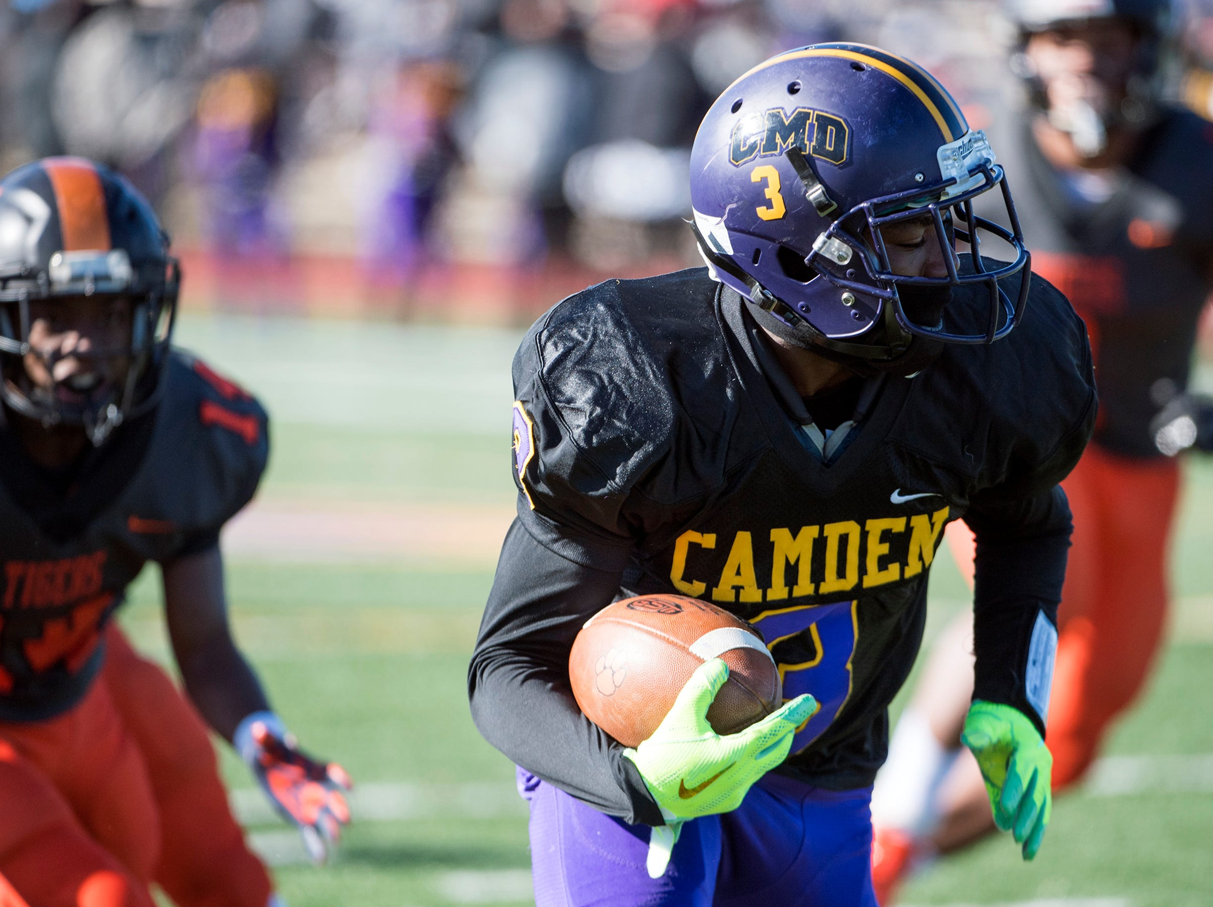 Camden's Darian ÒDuceÓ Chestnut (3) carries during an annual Camden-Woodrow Wilson Thanksgiving game Thursday, Nov. 22, 2018 in Camden, N.J. Camden won 39-28.