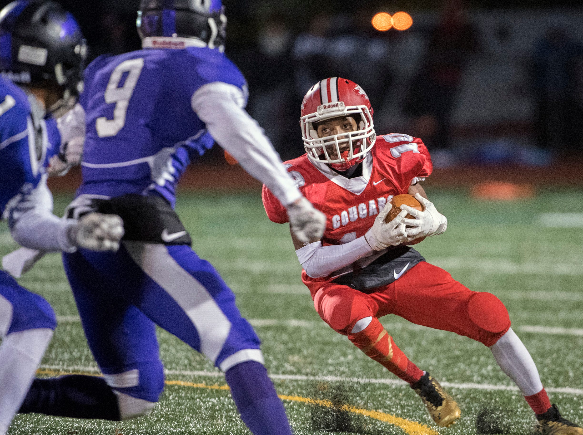 East's Isaac Jean-Baptiste (10) carries the ball during an annual East-West game Wednesday, Nov. 21, 2018 at Cherry Hill West High School in Cherry Hill, N.J. West won 22-7.