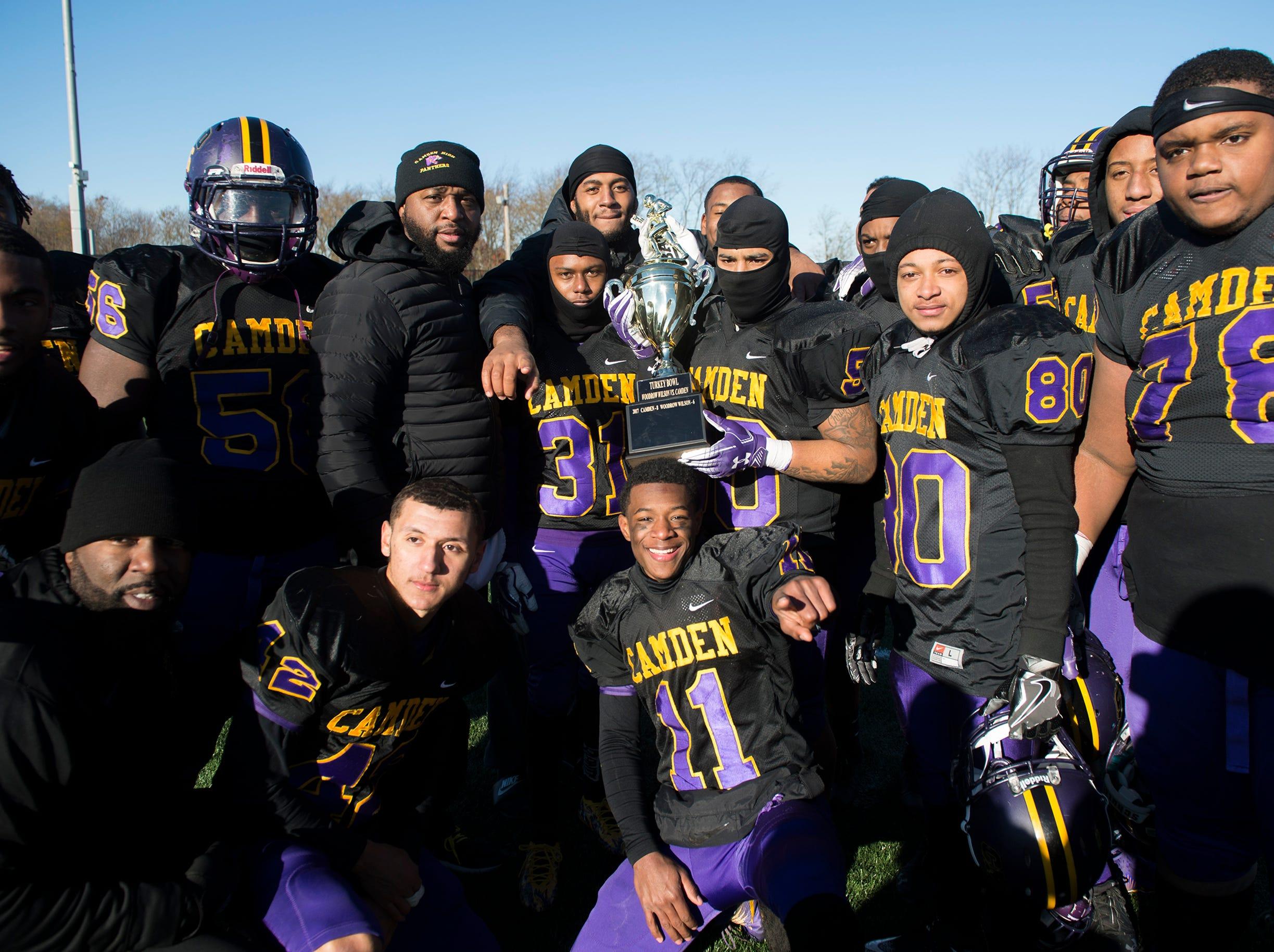 Camden poses with their trophy following an annual Camden-Woodrow Wilson Thanksgiving game Thursday, Nov. 22, 2018 in Camden, N.J. Camden won 39-28.