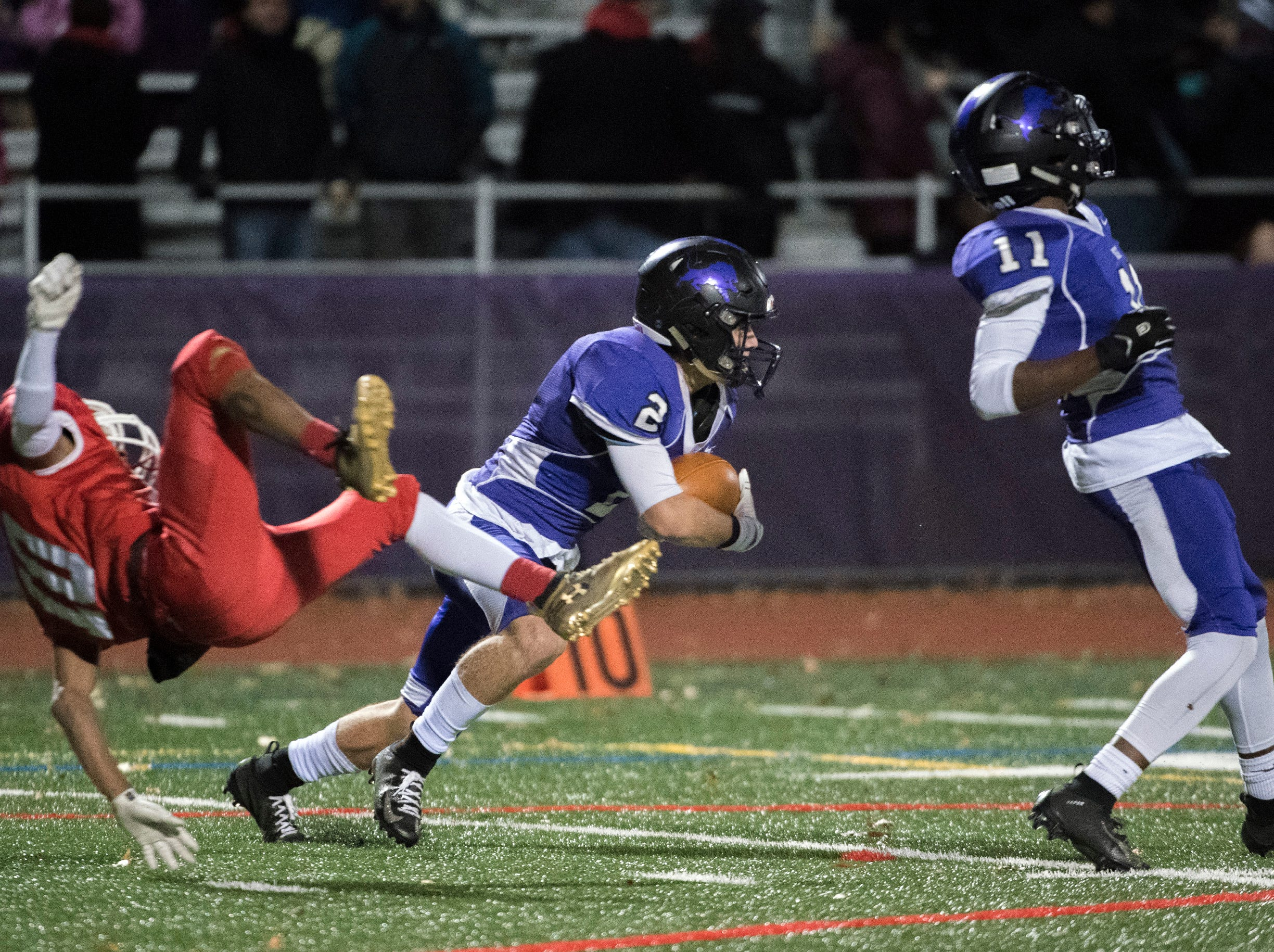 West's Johnny Ioannucci (2) intercepts the ball during an annual East-West game Wednesday, Nov. 21, 2018 at Cherry Hill West High School in Cherry Hill, N.J. West won 22-7.