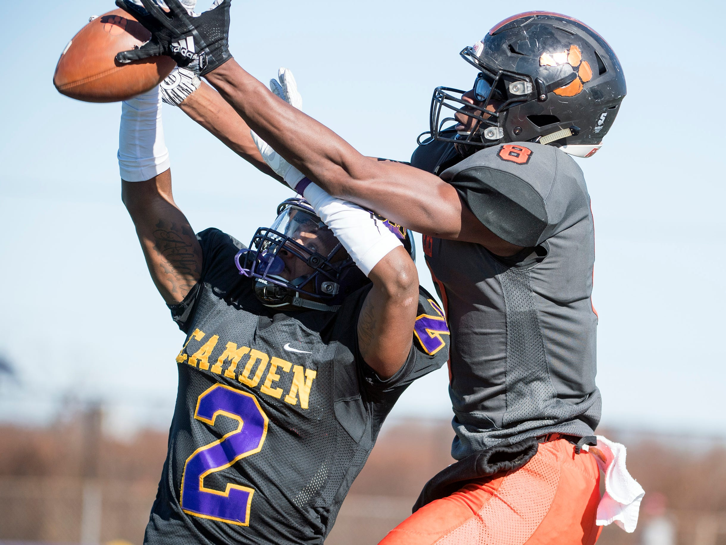 Camden's Donald Williams (2) and Woodrow Wilson's Stanley King (8) battle for a pass that ultimately falls incomplete during an annual Camden-Woodrow Wilson Thanksgiving game Thursday, Nov. 22, 2018 in Camden, N.J. Camden won 39-28.