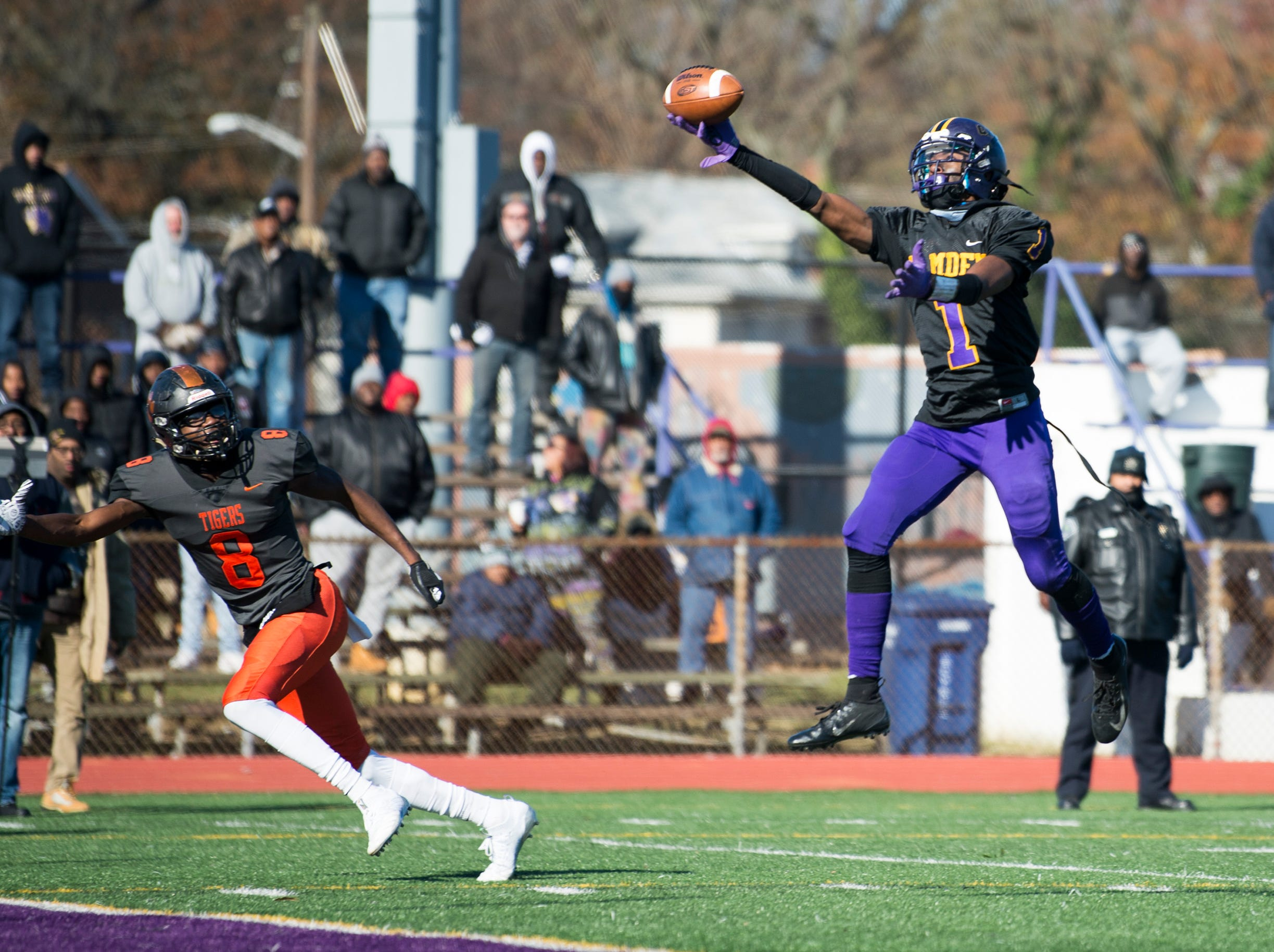 A pass soars out of reach for Camden's Corey Palmer (1) before Woodrow Wilson's Stanley King (8) intercepts it during an annual Camden-Woodrow Wilson Thanksgiving game Thursday, Nov. 22, 2018 in Camden, N.J. Camden won 39-28.