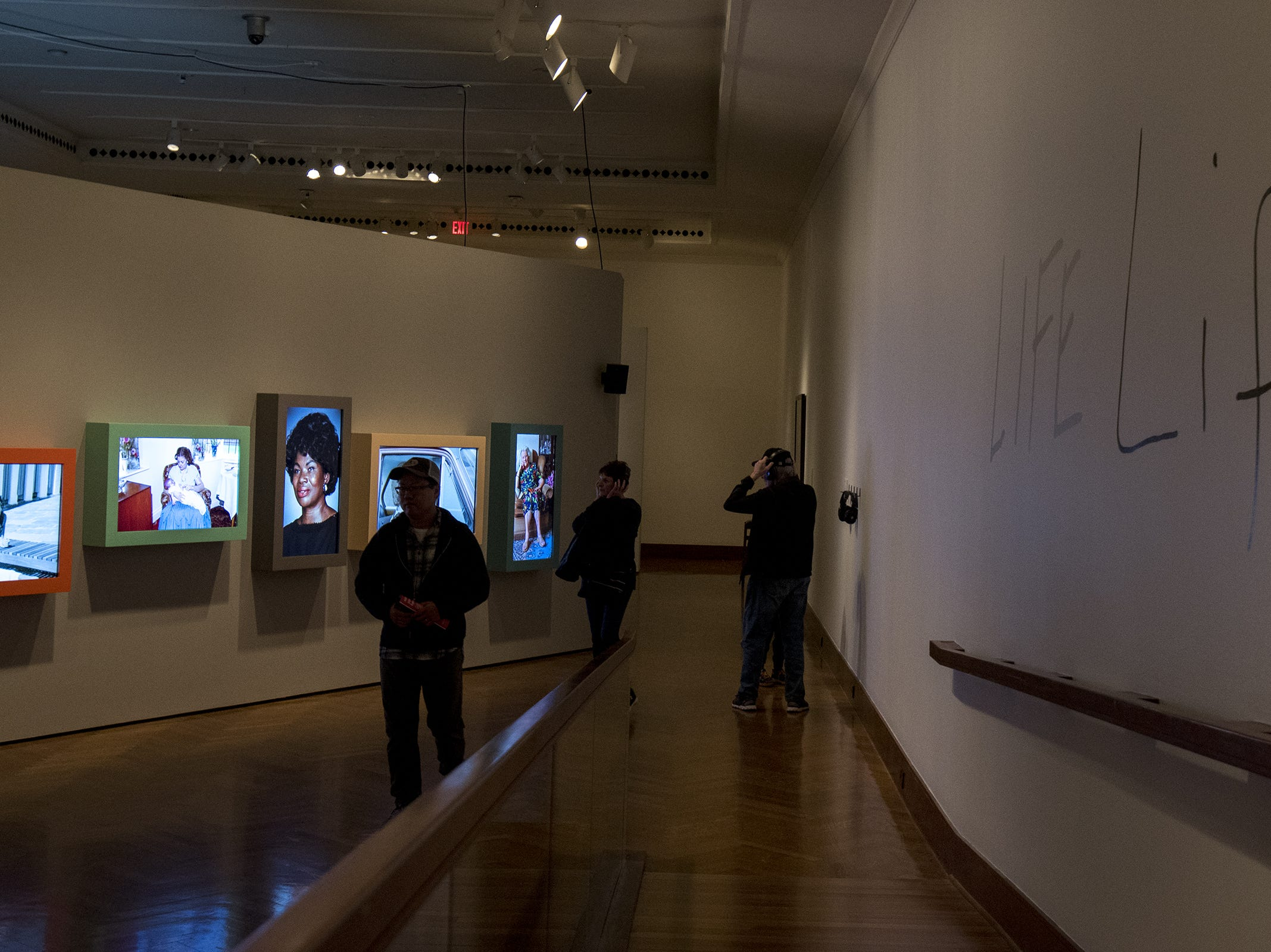 Guests listen to the audio tour of Life: Gillian Wearing during Art After Dark at Cincinnati Art Museum Wednesday, November 21, 2018 in Cincinnati, Ohio.