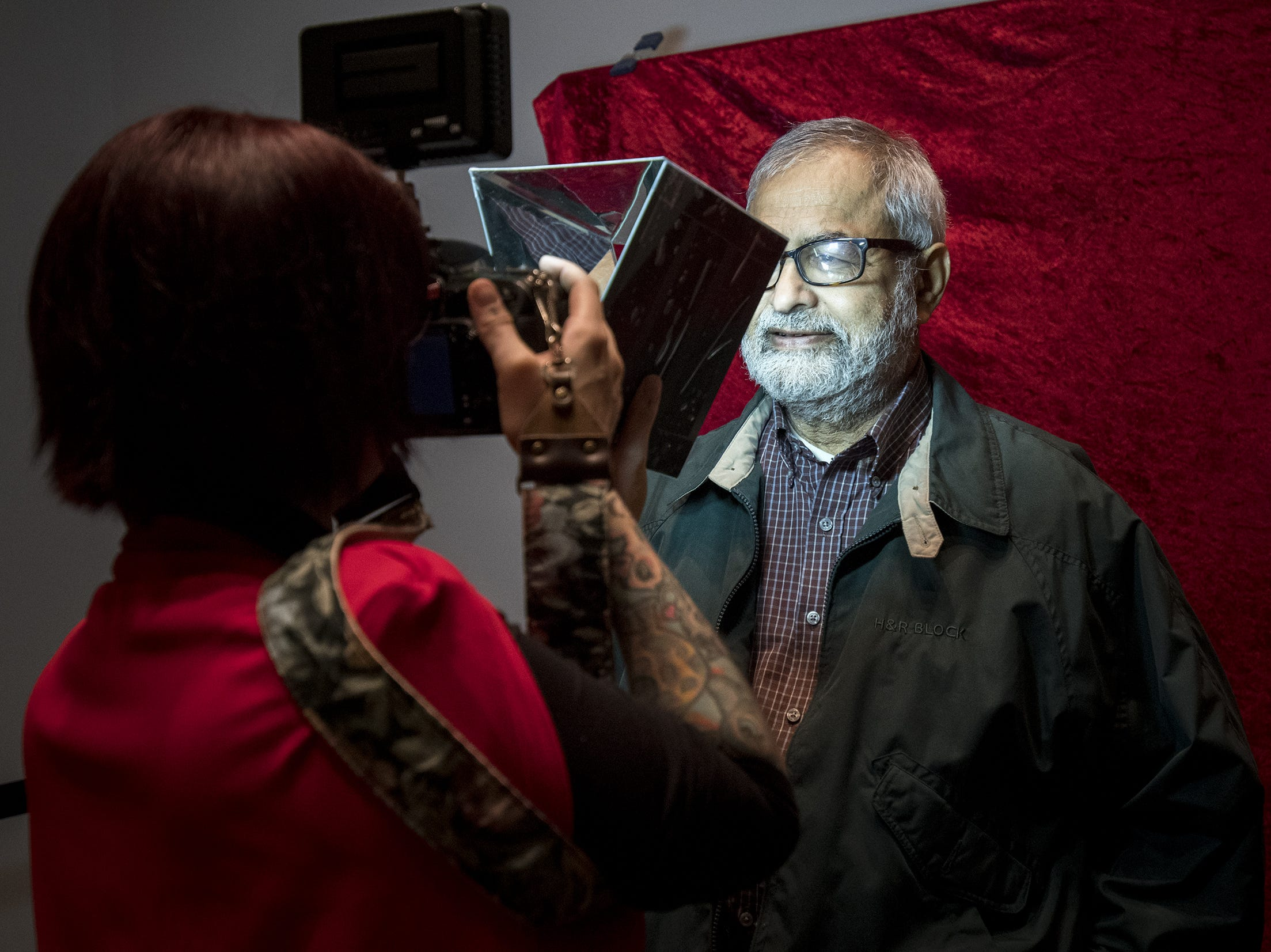 Photographer Jesse Fox takes the photo of Ramesh Shanbhag at a free photo booth during Art After Dark at the Cincinnati Art Museum Wednesday, November 21, 2018 in Cincinnati, Ohio.