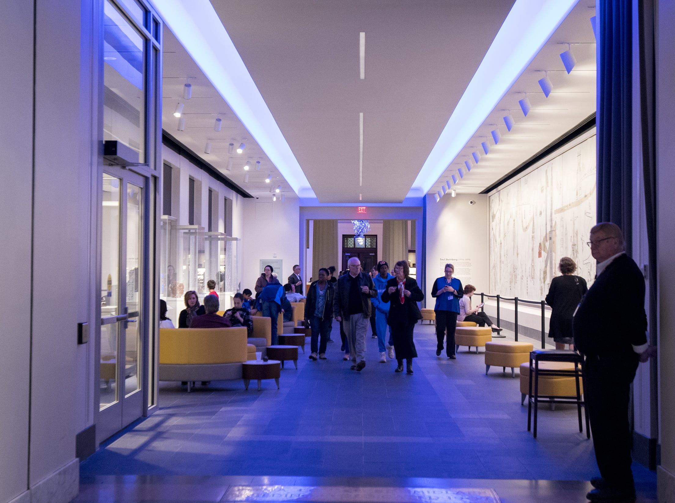 Guests enter the Cincinnati Art Museum for Art After Dark: Confess Yourself Wednesday, November 21, 2018 in Cincinnati, Ohio.