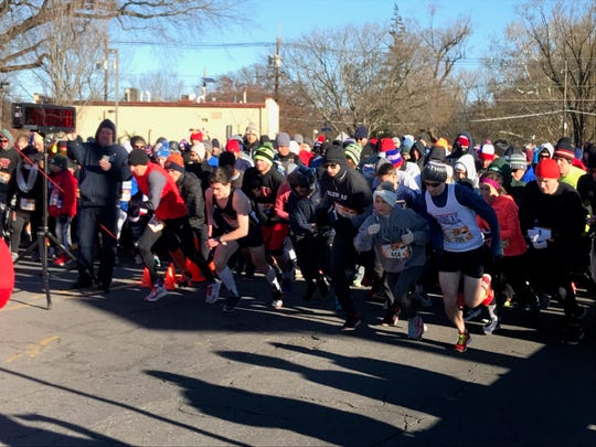 Runners take off at the start of the Somerville 5k Turkey Trot on Thanksgiving Day.