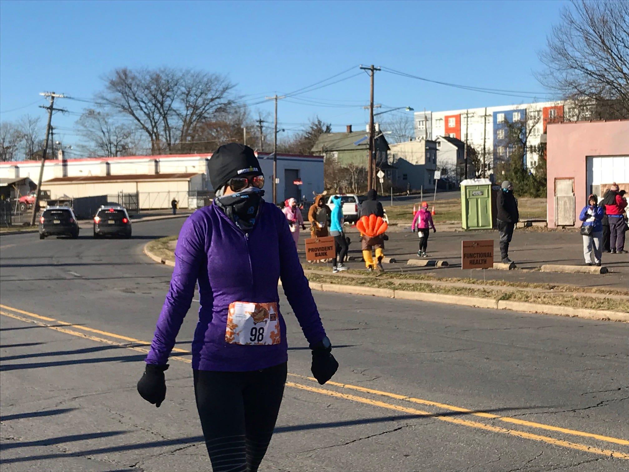 A bundled up runner prepares to run in the Somerville 5K Turkey Trot on Thanksgiving.