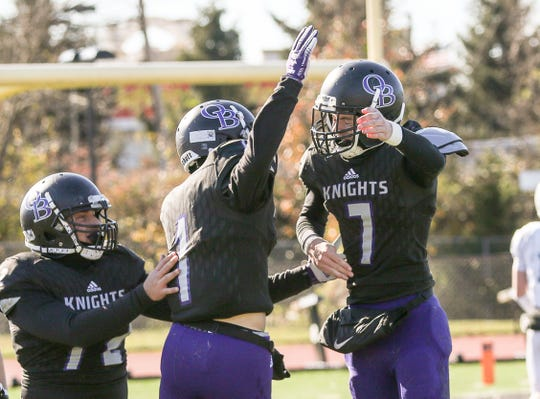 Old Bridge's Bryson Corbett (left) and quarterback Owen Haughney celebrate Corbett's third-quarter touchdown against East Brunswick Thursday, Nov. 22, 2018.