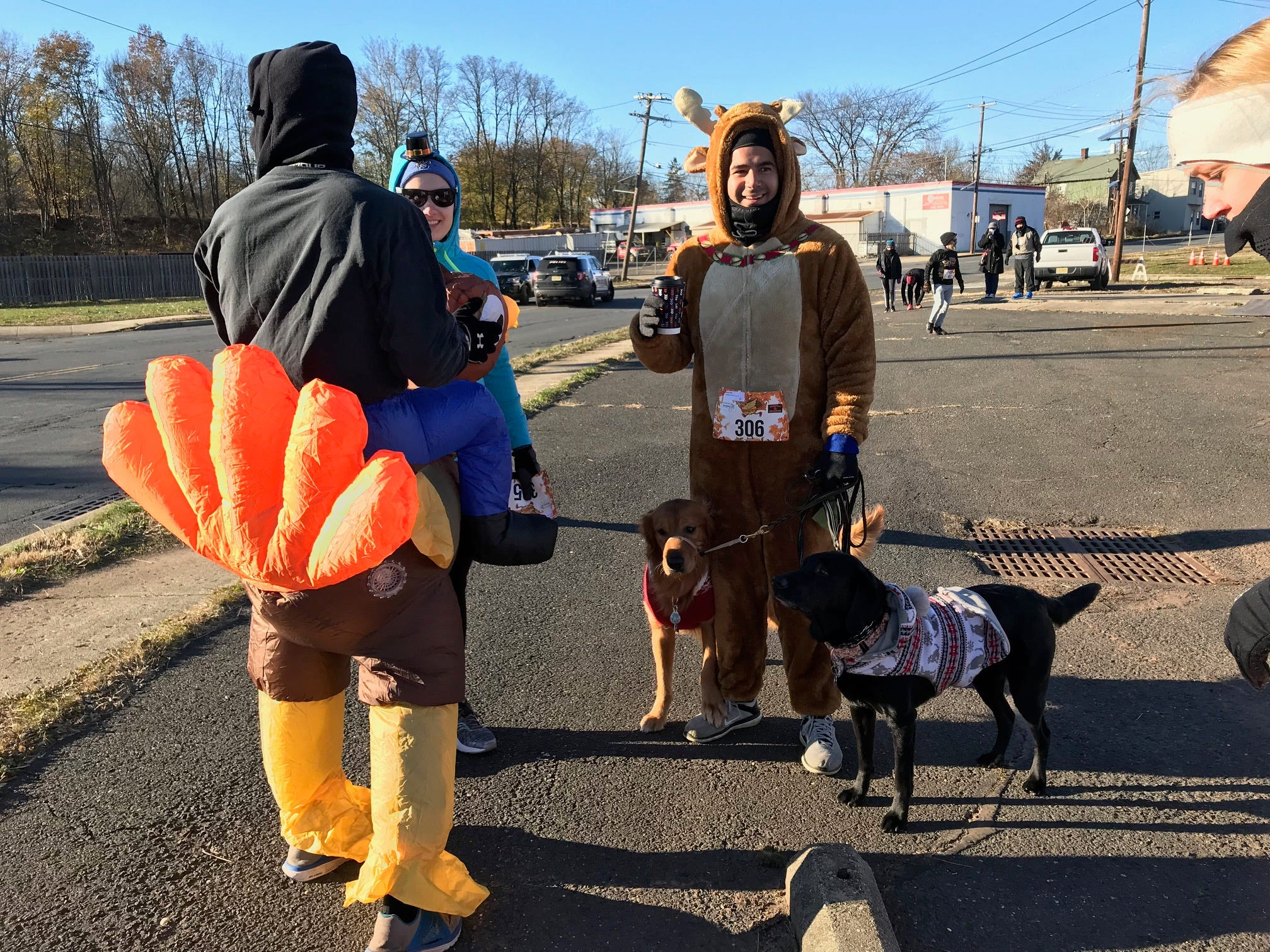 Several dogs with their owners participated in the Somerville 5K Turkey Trot on Thanksgiving Day.