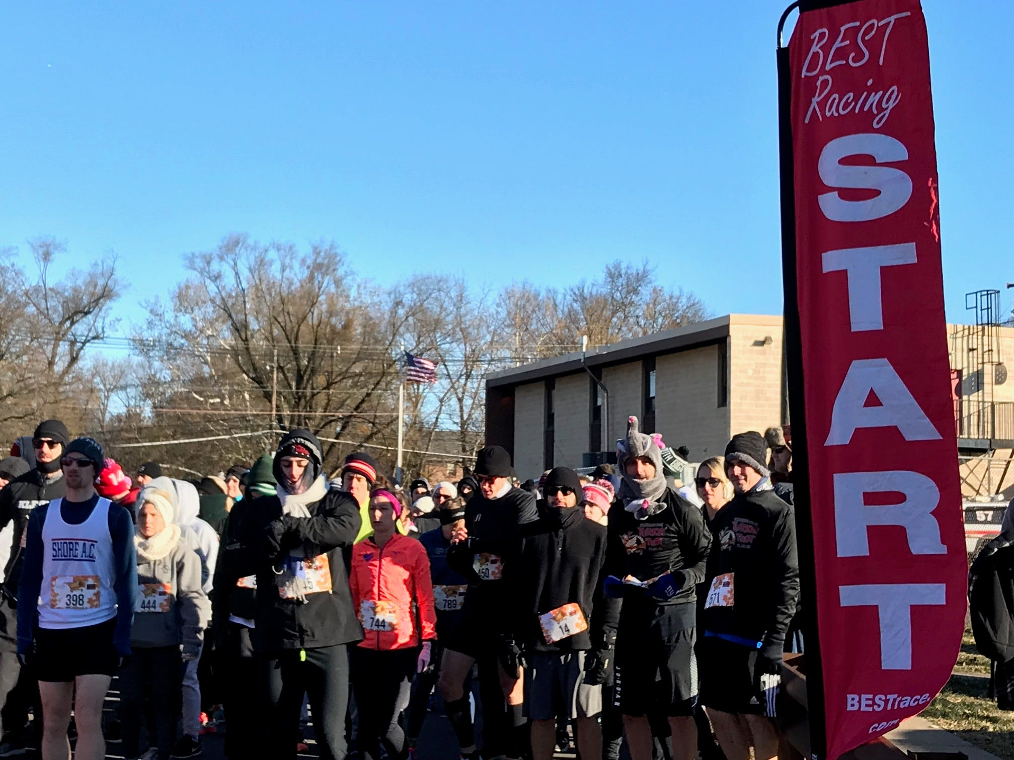 Runners line up at the start line for the Somerville Turkey Trot on Thanksgiving Day.