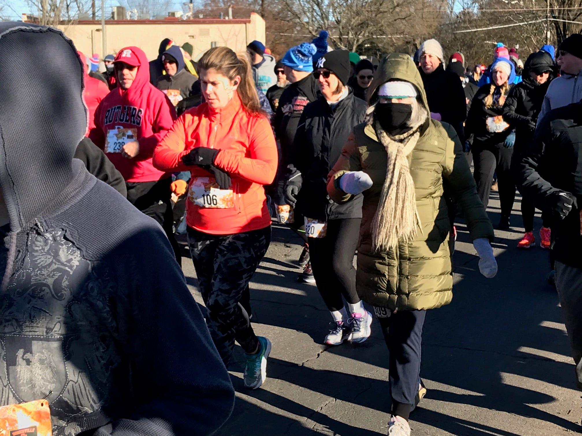 Runners begin the Somerville Turkey Trot on Thanksgiving Day.