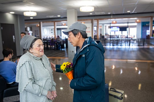 Ky Phan Luong poses for a photo with an old friend, Jan Fleming, as he and his family arrived in Iowa to visit, on Thursday, Nov. 22, 2018, at the Des Moines International Airport. Luong came to Des Moines as a refugee from Vietnam in 1978.