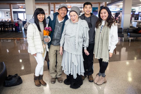 Hollie and Ky Phan Luong, Jan Fleming, and Jacquelyn and Mitchell Luong pose for a photo after arriving in Iowa to visit on Thursday, Nov. 22, 2018, at the Des Moines International Airport. Phil Luong came to Des Moines as a refugee from Vietnam in the late 1970s.