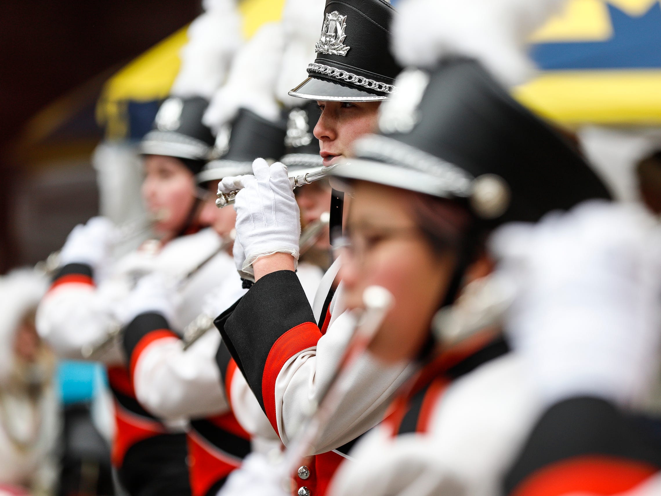 Brighton High School marching band members makes their way down Woodward Avenue during the 92nd America's Thanksgiving Day Parade in Detroit, Thursday, Nov. 22, 2018.