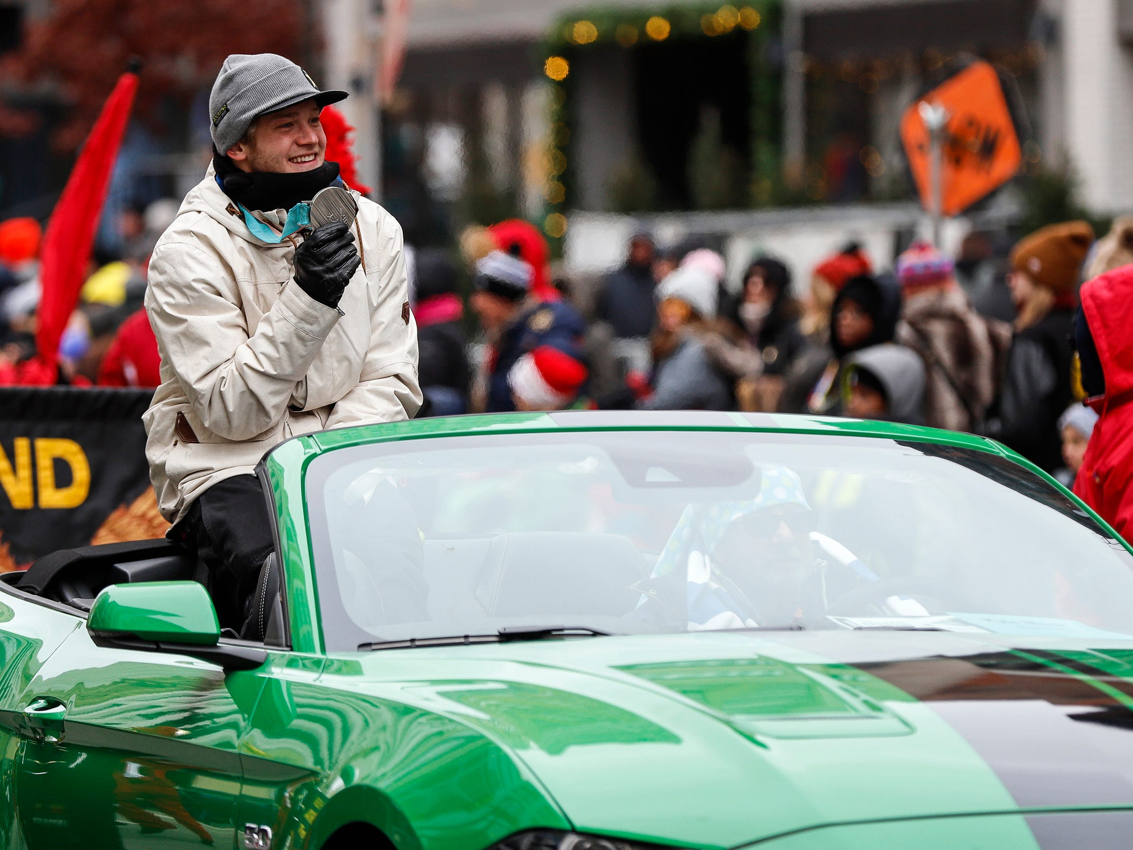 Olympic silver medalist Kyle Mack shows off his medal during the 92nd America's Thanksgiving Day Parade in Detroit, Thursday, Nov. 22, 2018.