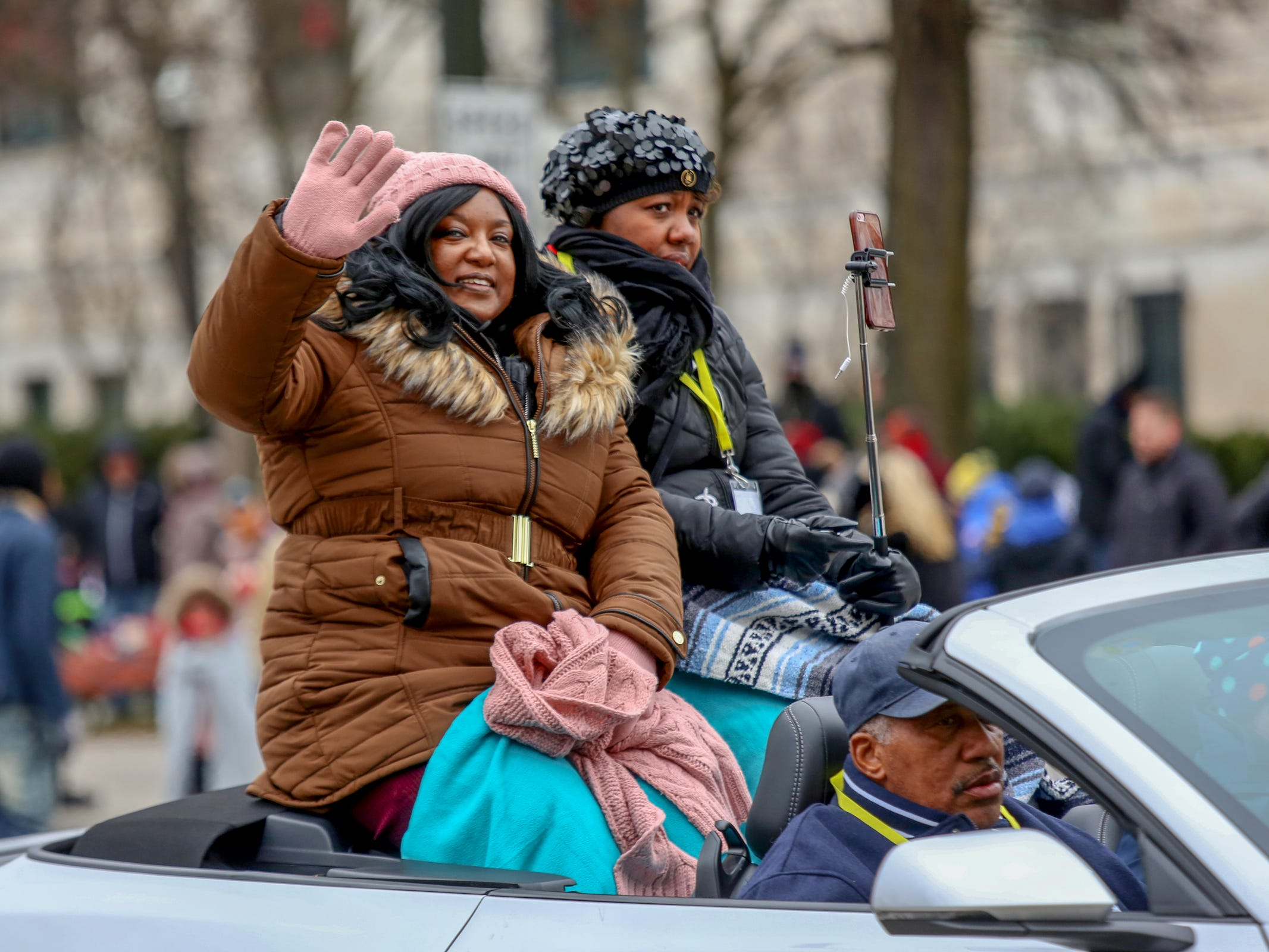 Aretha Franklin's family members wave to the crowd, during America's Thanksgiving Parade in Detroit on Thursday, Nov. 22, 2018.