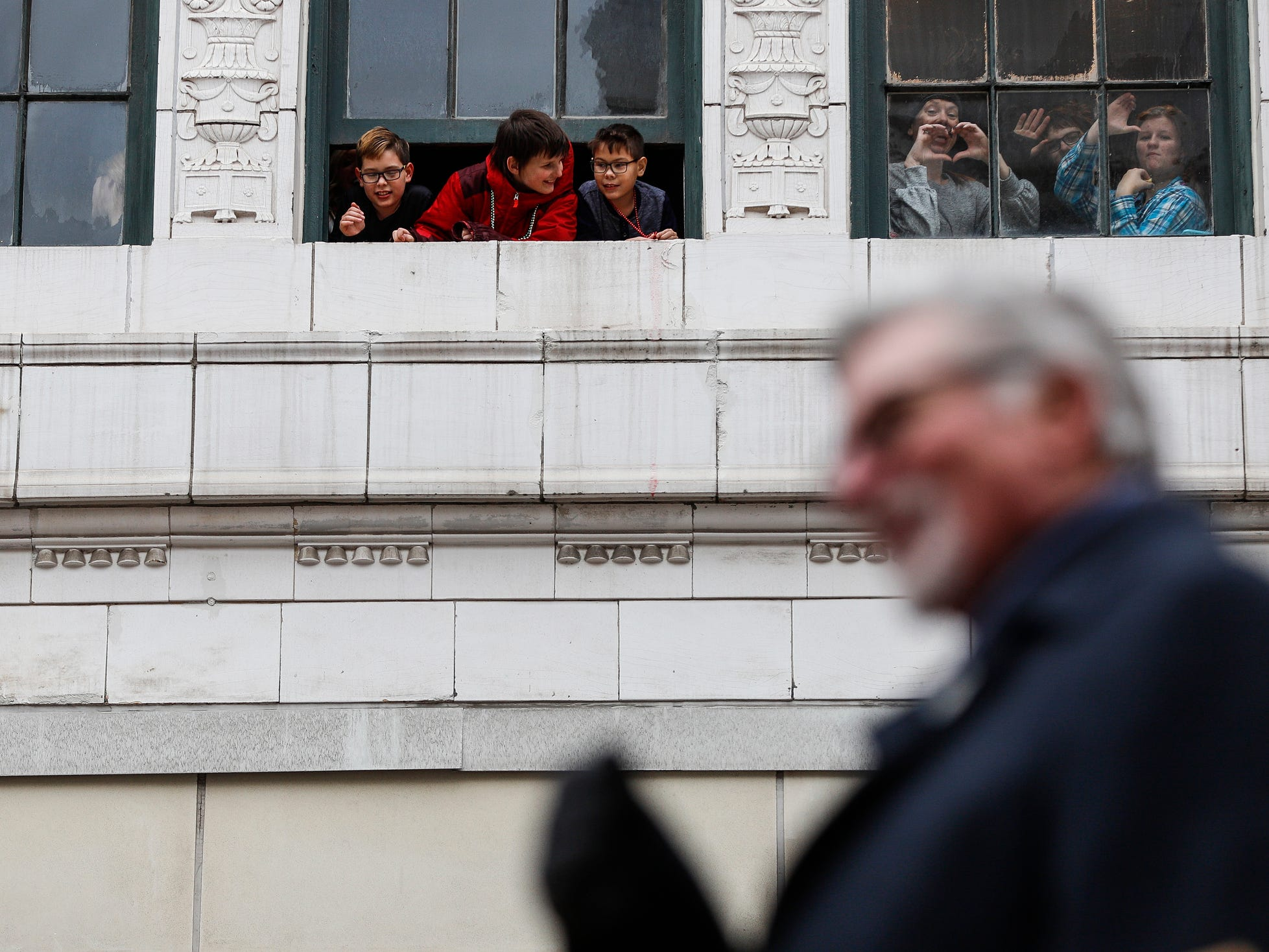 Spectators watch the parade as former Detroit Tigers pitcher Jack Morris goes by on Woodward Avenue during the 92nd America's Thanksgiving Day Parade in Detroit, Thursday, Nov. 22, 2018.