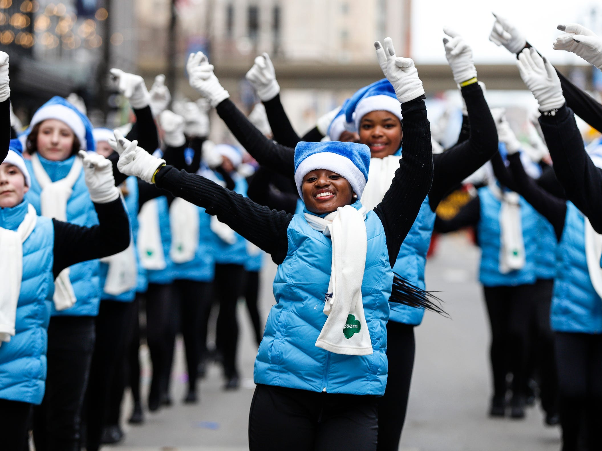 Parade participants from Southeastern Michigan Girl Scout make their way down Woodward Avenue during the 92nd America's Thanksgiving Day Parade in Detroit, Thursday, Nov. 22, 2018.