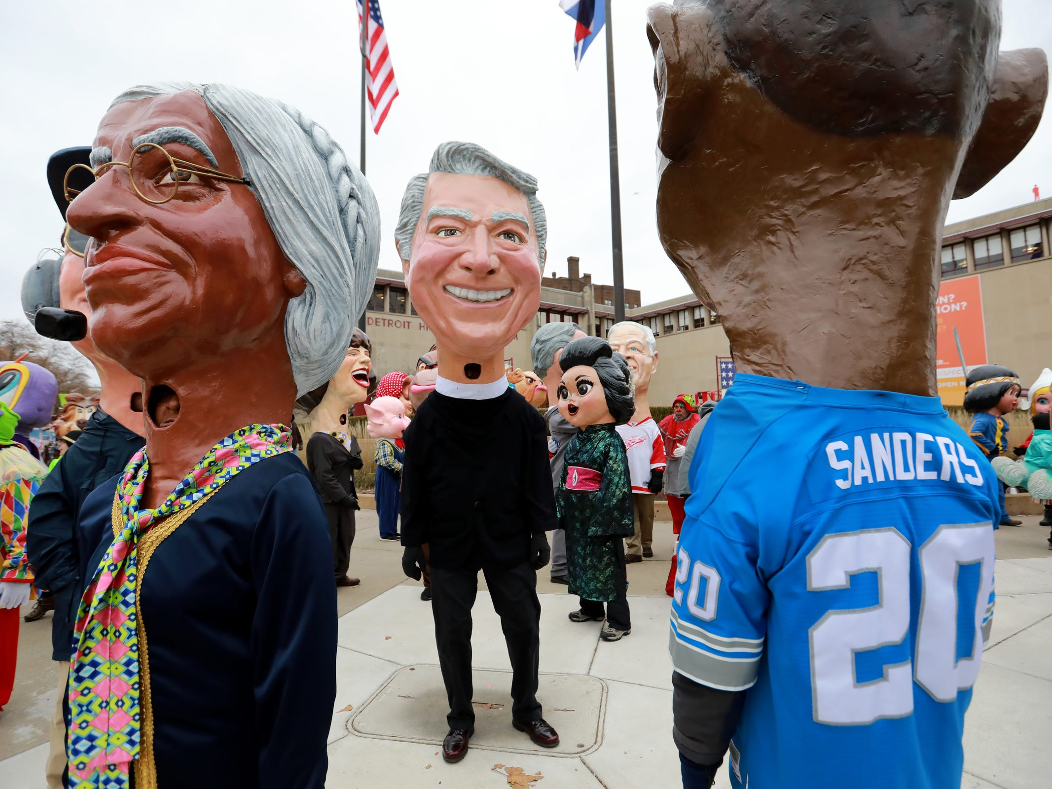 Big Heads made out of papier-mache stand outside of the Detroit Historical Museum waiting to join America's Thanksgiving Parade in Detroit on Thursday, Nov. 22, 2018.