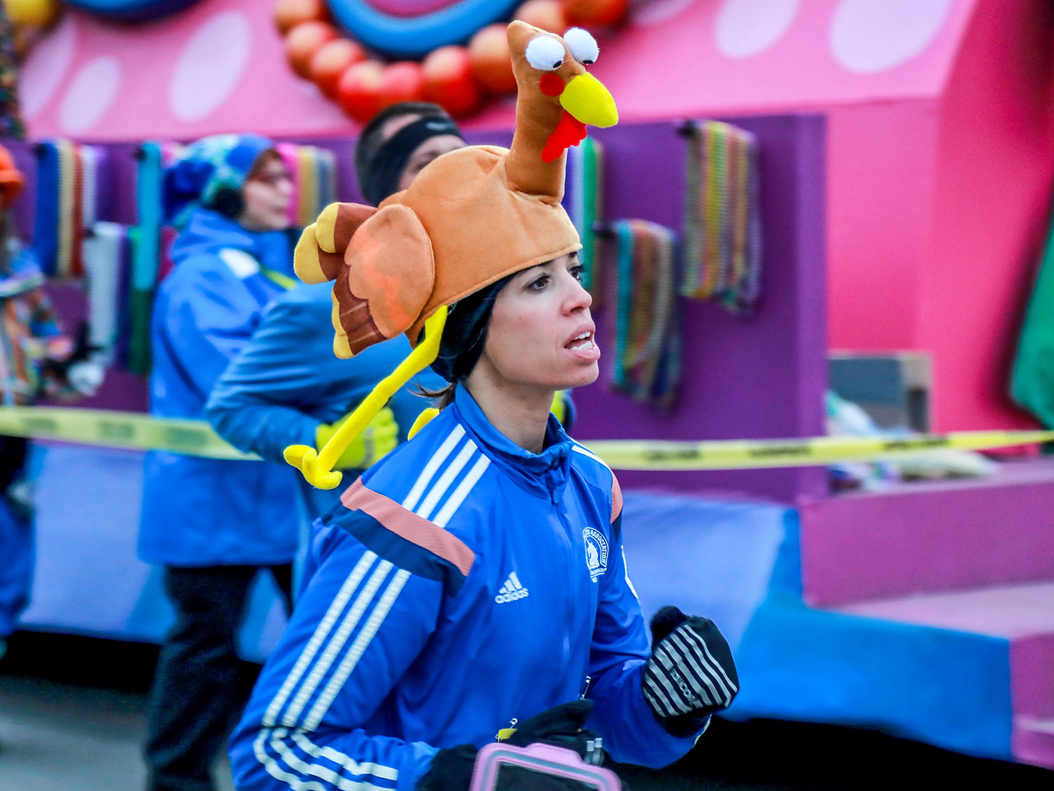 Runners participate in the Turkey Trot before the start of America's Thanksgiving Parade in Detroit on Thursday, Nov. 22, 2018.