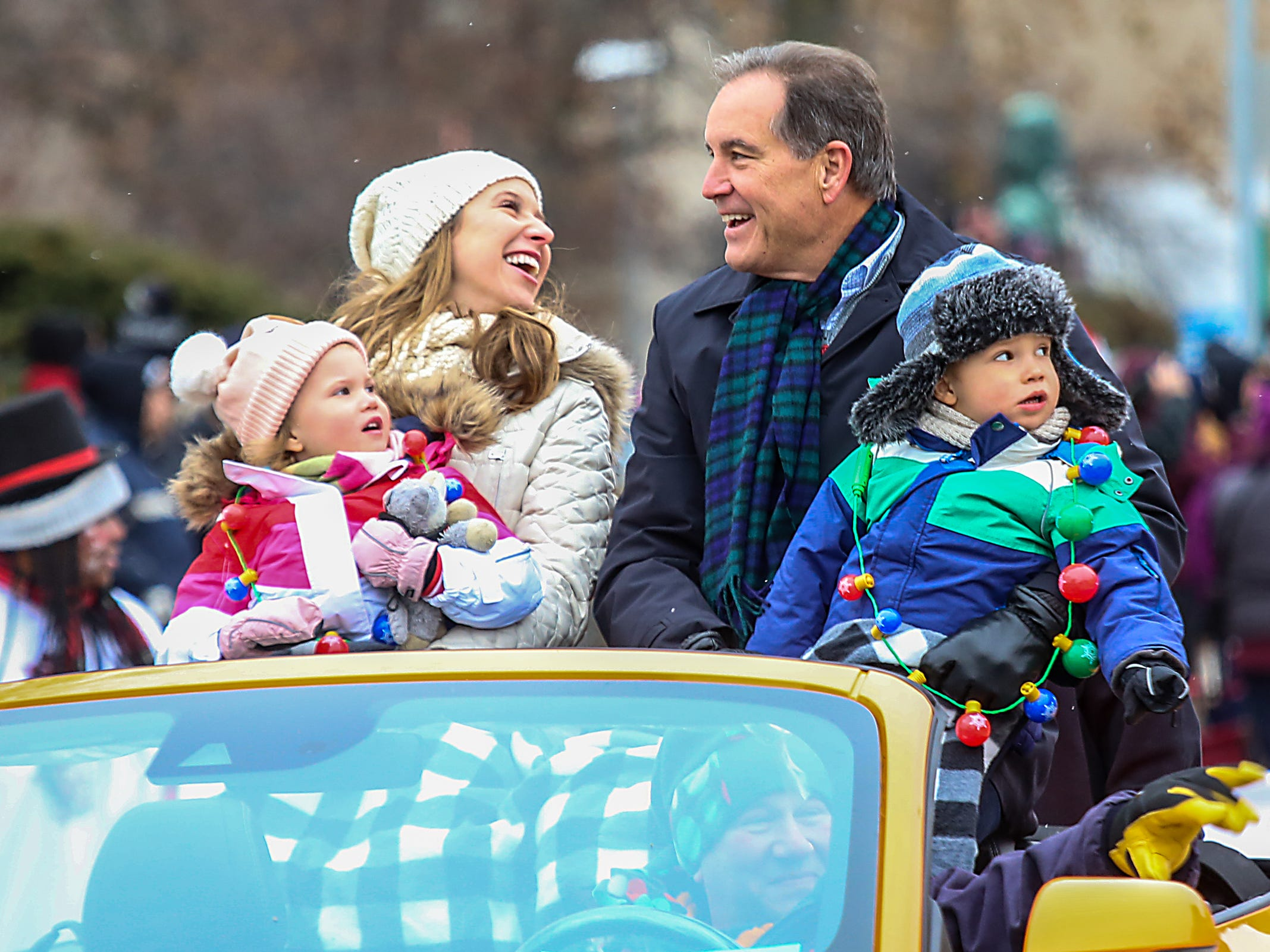 Grand Marshal Jim Nantz, sportscaster, waves to the crowd with his family, during America's Thanksgiving Parade in Detroit on Thursday, Nov. 22, 2018.