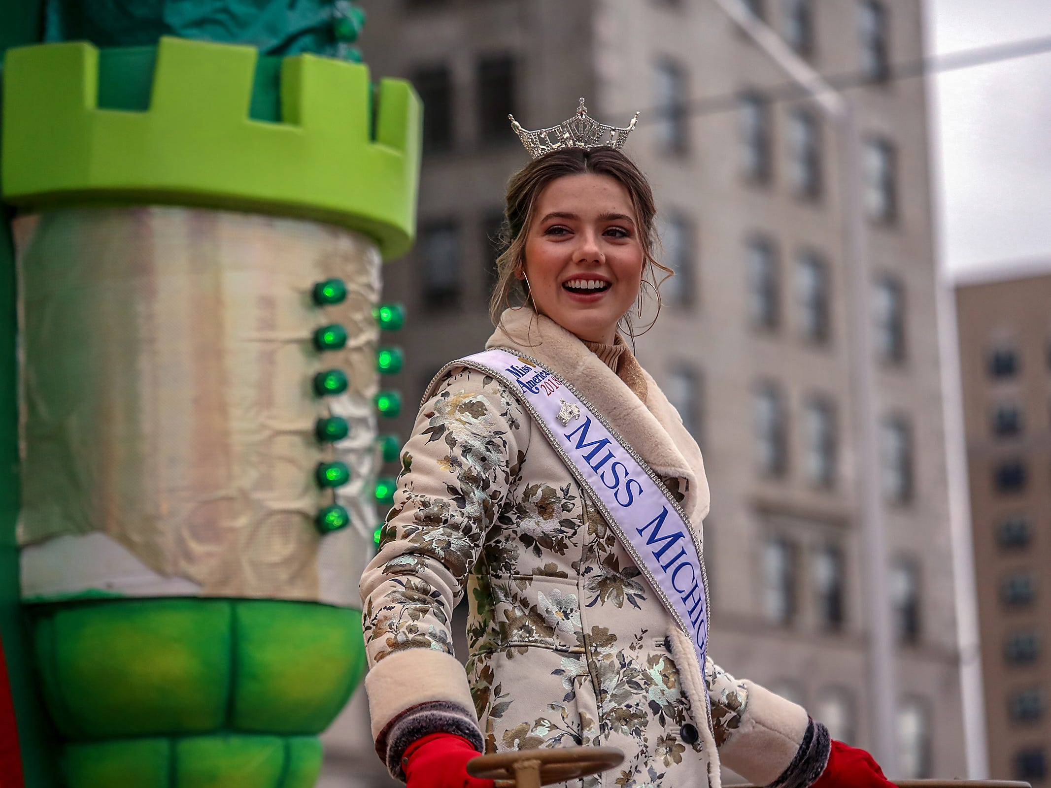 Miss Michigan Emily Sioma rides a float, during America's Thanksgiving Parade in Detroit on Thursday, Nov. 22, 2018.