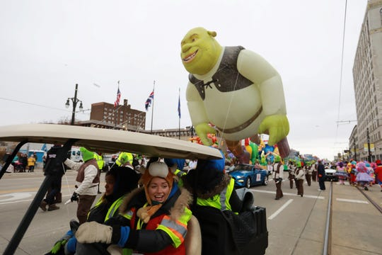 Disco dogs and cats wait with the Shrek float at the start of America's Thanksgiving Parade presented by Art Van in Detroit on Thursday, Nov. 22, 2018.