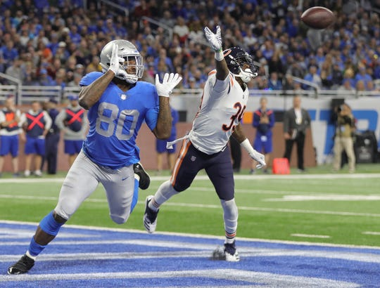 Lions tight end Michael Roberts is defended by Bears safety Eddie Jackson during the second half of the Lions' 23-16 loss to the Bears on Thursday, Nov. 22, 2018, at Ford Field.