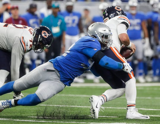 Lions defensive end Ziggy Ansah sacks Bears quarterback Chase Daniel from behind during the second half of the Lions' 23-16 loss to the Bears on Thursday, Nov. 22, 2018, at Ford Field.