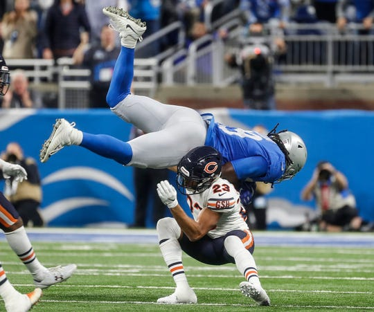 Lions running back LeGarrette Blount tries to jump over Bears cornerback Kyle Fuller during the second half of the Lions' 23-16 loss to the Bears on Thursday, Nov. 22, 2018, at Ford Field.
