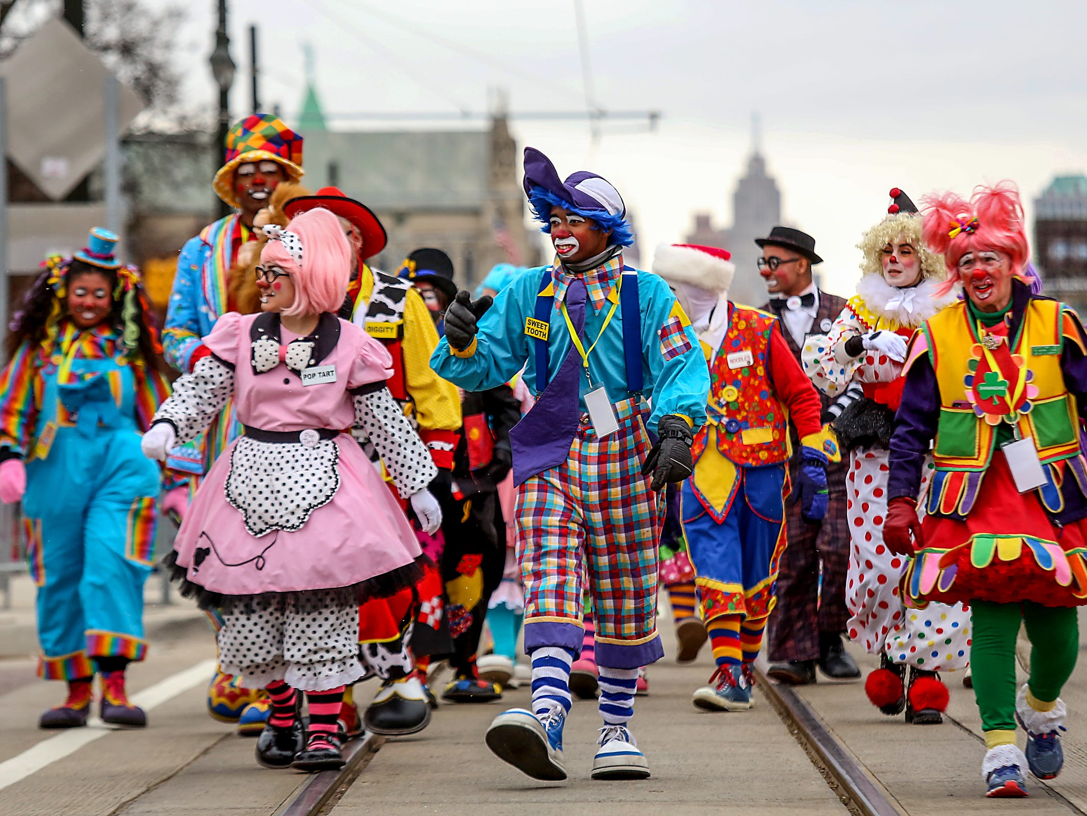 Mott Campus Clowns, of Mott Community College participate in America's Thanksgiving Parade in Detroit on Thursday, Nov. 22, 2018.