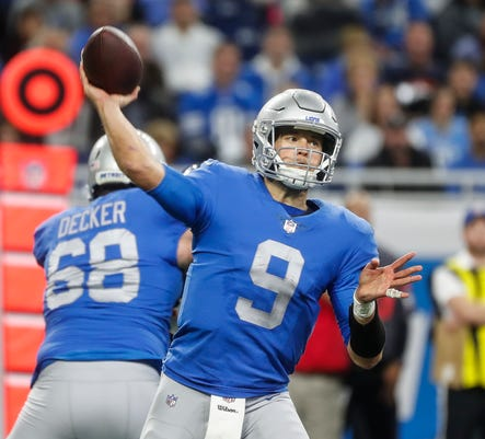 Lions quarterback Matthew Stafford (9) makes a pass against Bears during  the second half of the Lions  23-16 loss to the Bears on Thursday 35bddff9a