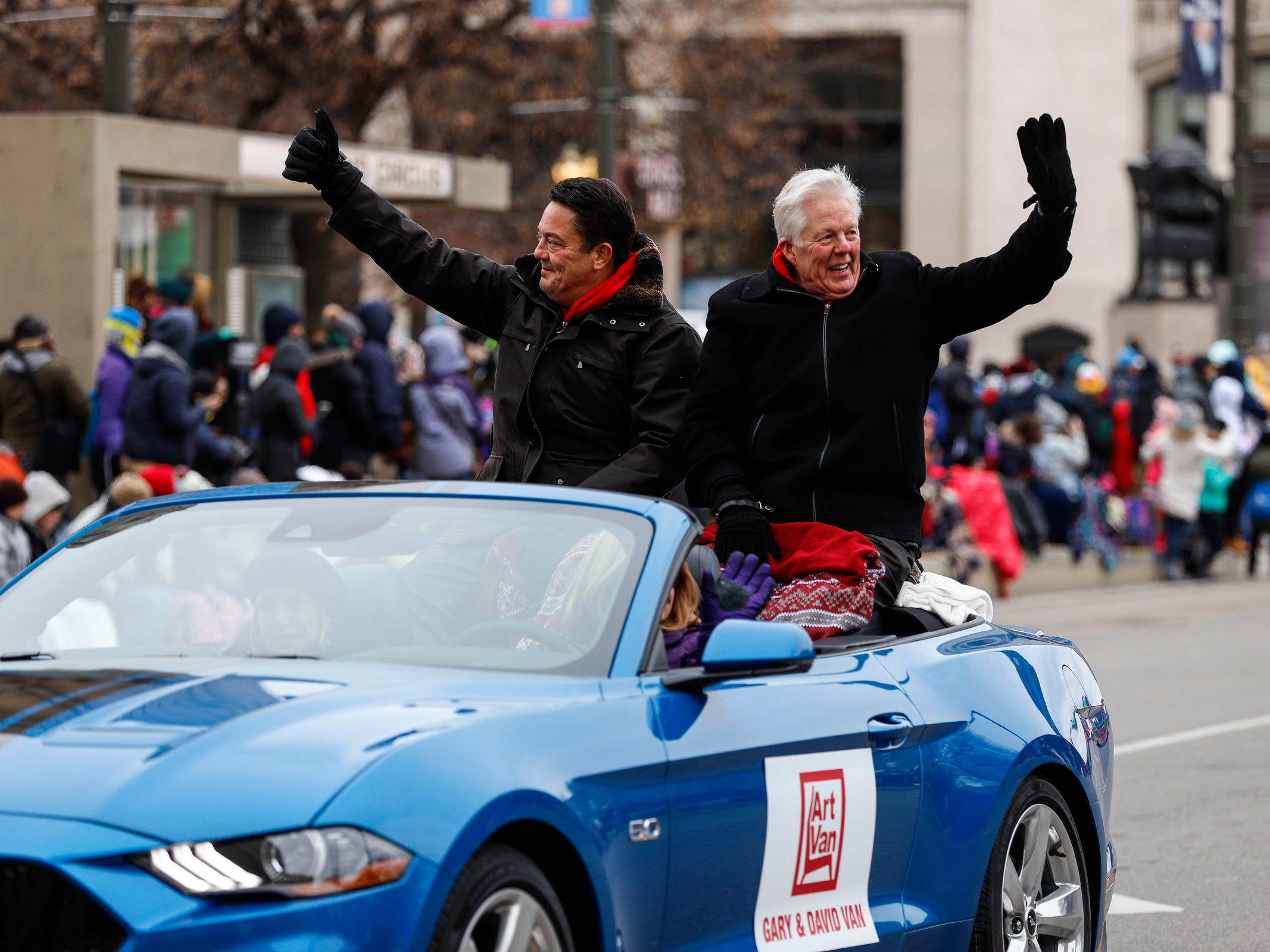 Gary and David Van Elslander of Art Van Furniture wave at the crowd during the 92nd America's Thanksgiving Day Parade in Detroit, Thursday, Nov. 22, 2018.