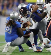 Lions defensive lineman Damon Harrison sacks Bears quarterback Chase Daniels during the first half on Thursday, Nov. 22, 2018, at Ford Field.
