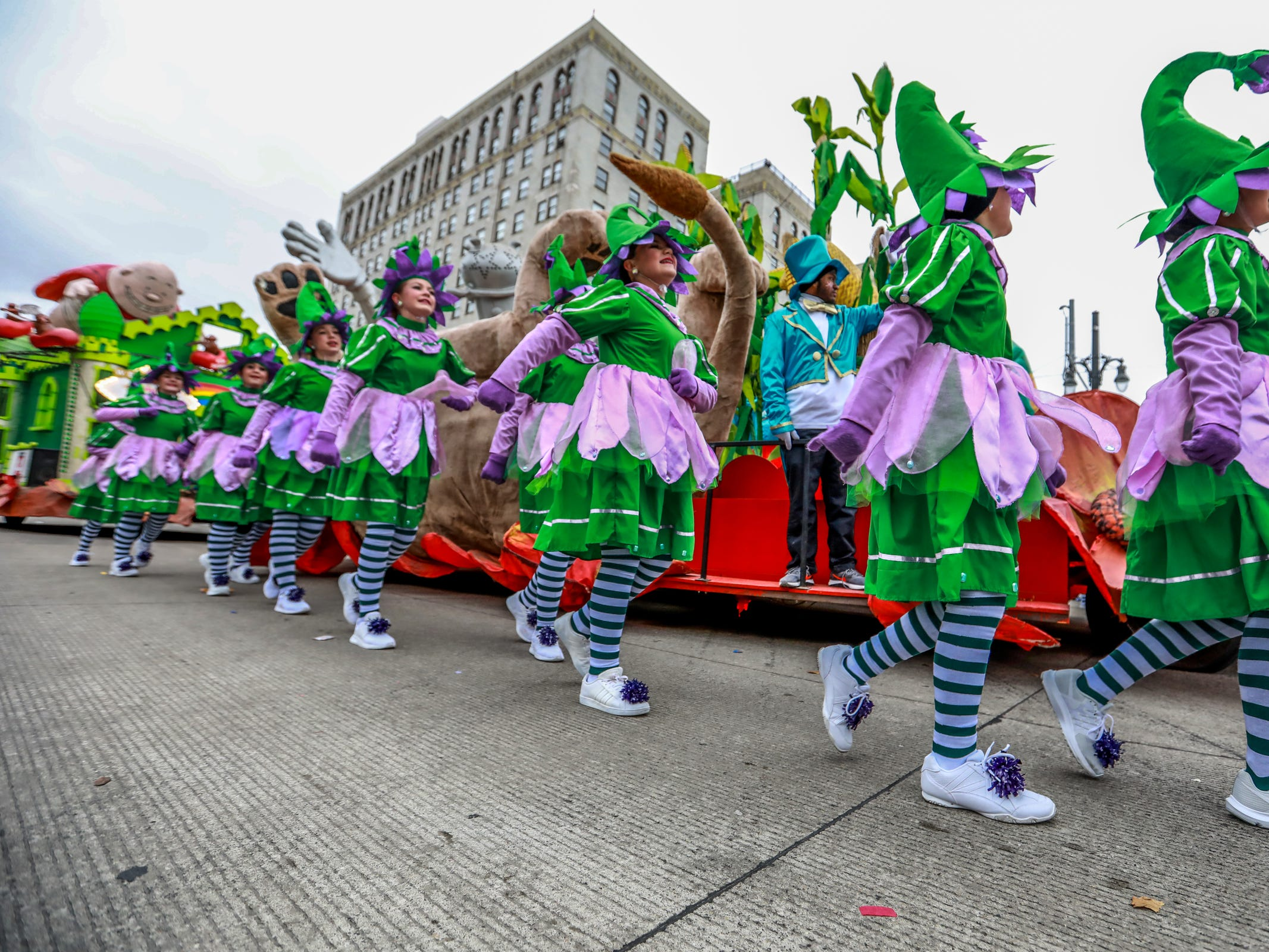 Dancers from Tina Marie's dance school, perform alongside a float, during America's Thanksgiving Parade in Detroit on Thursday, Nov. 22, 2018.