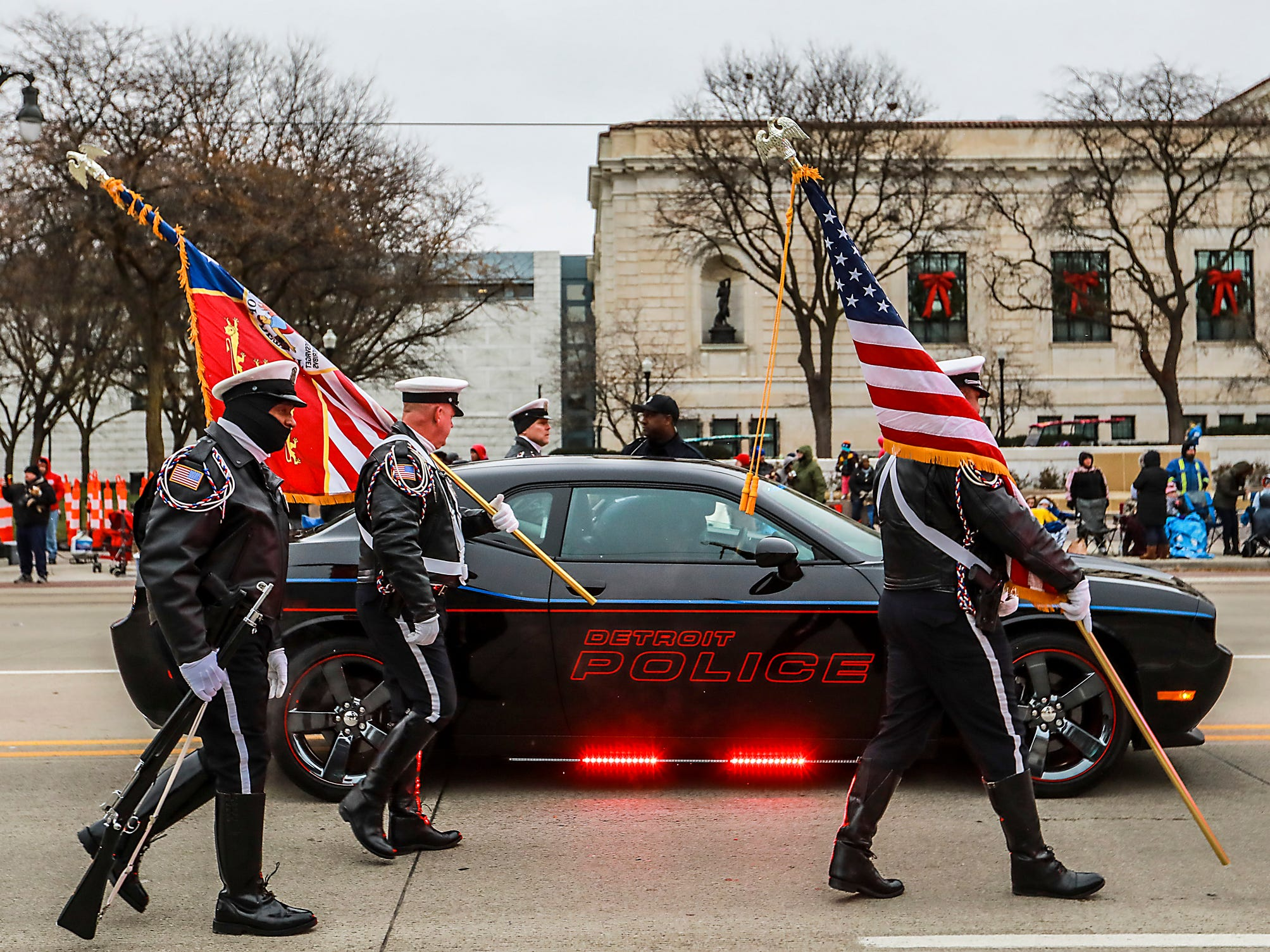 The Detroit Police Color Guard walks to the front to begin America's Thanksgiving Parade in Detroit on Thursday, Nov. 22, 2018.