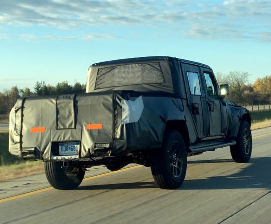 Camouflaged Jeep Scrambler, er, Gladiator, travels along Interstate 94 in the Detroit area on Oct. 23, 2018.