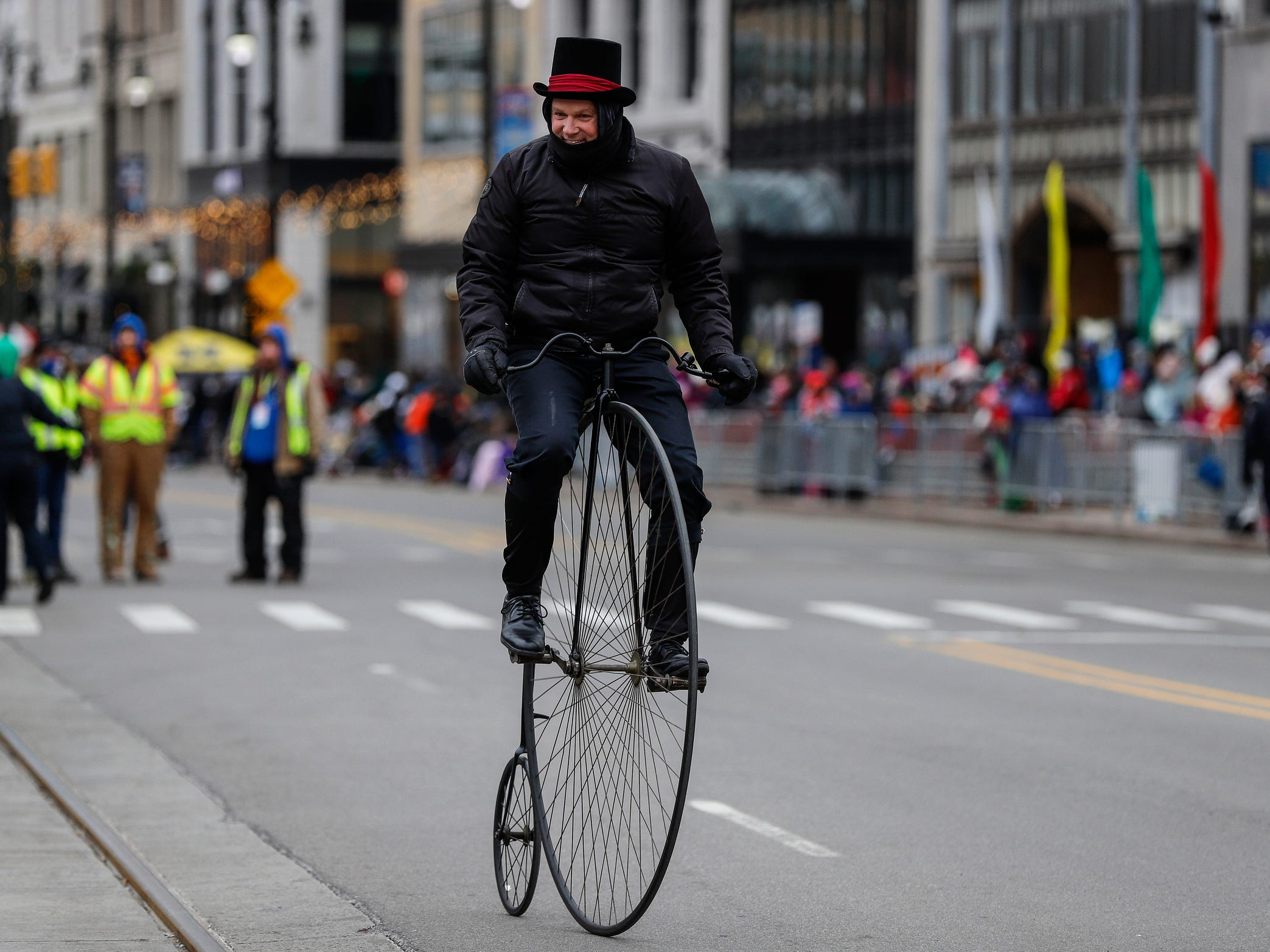 Joe Considine rides his 1884 Coventry high wheel on Woodward Avenue during the 92nd America's Thanksgiving Day Parade in Detroit, Thursday, Nov. 22, 2018.