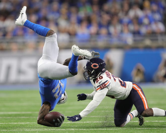 Lions receiver Bruce Ellington is tackled by Bears cornerback Deon Bush during the first half on Thursday, Nov. 22, 2018, at Ford Field.
