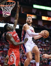 Detroit Pistons forward Blake Griffin, right, drives to the basket as Houston Rockets center Clint Capela defends during the first half of an NBA basketball game Wednesday, Nov. 21, 2018, in Houston.