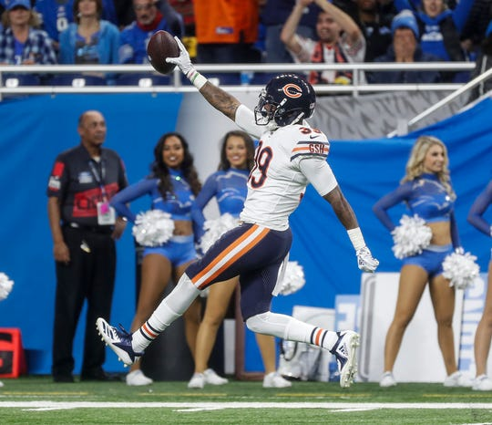 Bears safety Eddie Jackson celebrates an interception from Lions quarterback Matthew Stafford as he runs towards the end zone during the second half of the Lions' 23-16 loss to the Bears on Thursday, Nov. 22, 2018, at Ford Field.